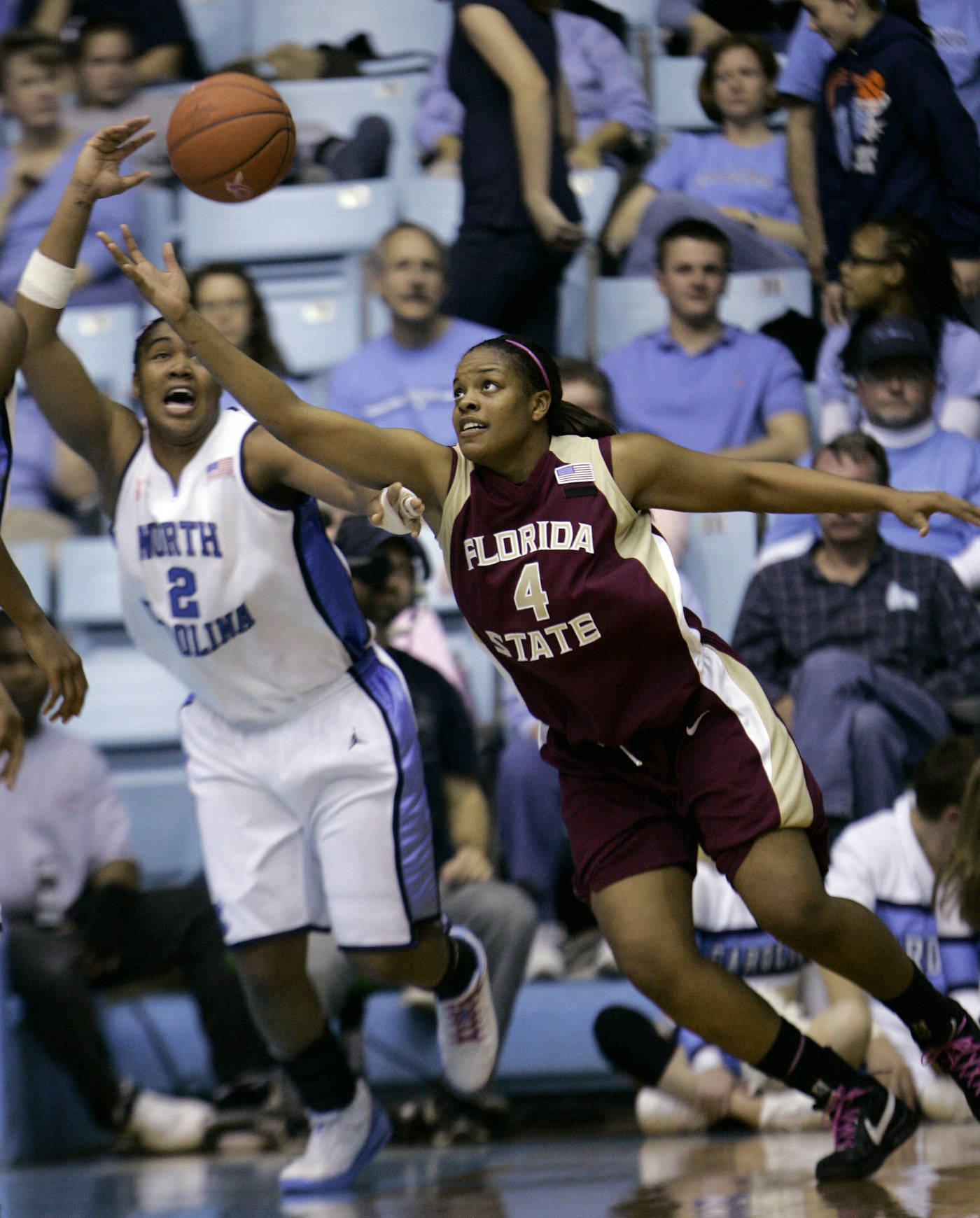 North Carolina's Erlana Larkins (2) and Florida State's Cayla Moore (4) battle for a rebound during the second half of a college basketball game in Chapel Hill, N.C., Sunday, Feb. 17, 2008. North Carolina won, 97-77. (AP Photo/Gerry Broome)