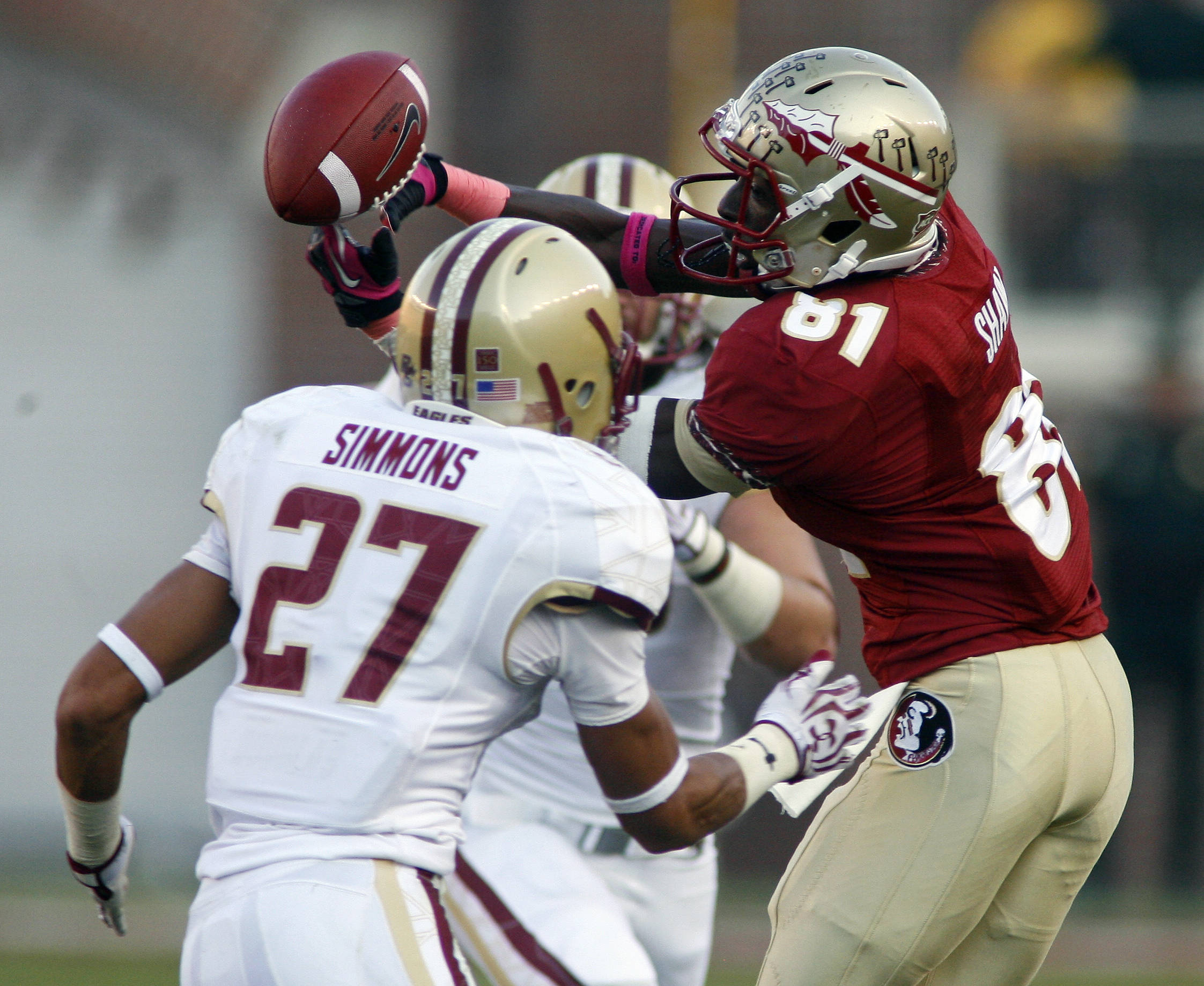 Florida State wide receiver Kenny Shaw (81) can't hold onto a pass as he is pressured by Boston College defensive back Justin Simmons (27) in the first quarter. (AP Photo/Phil Sears)
