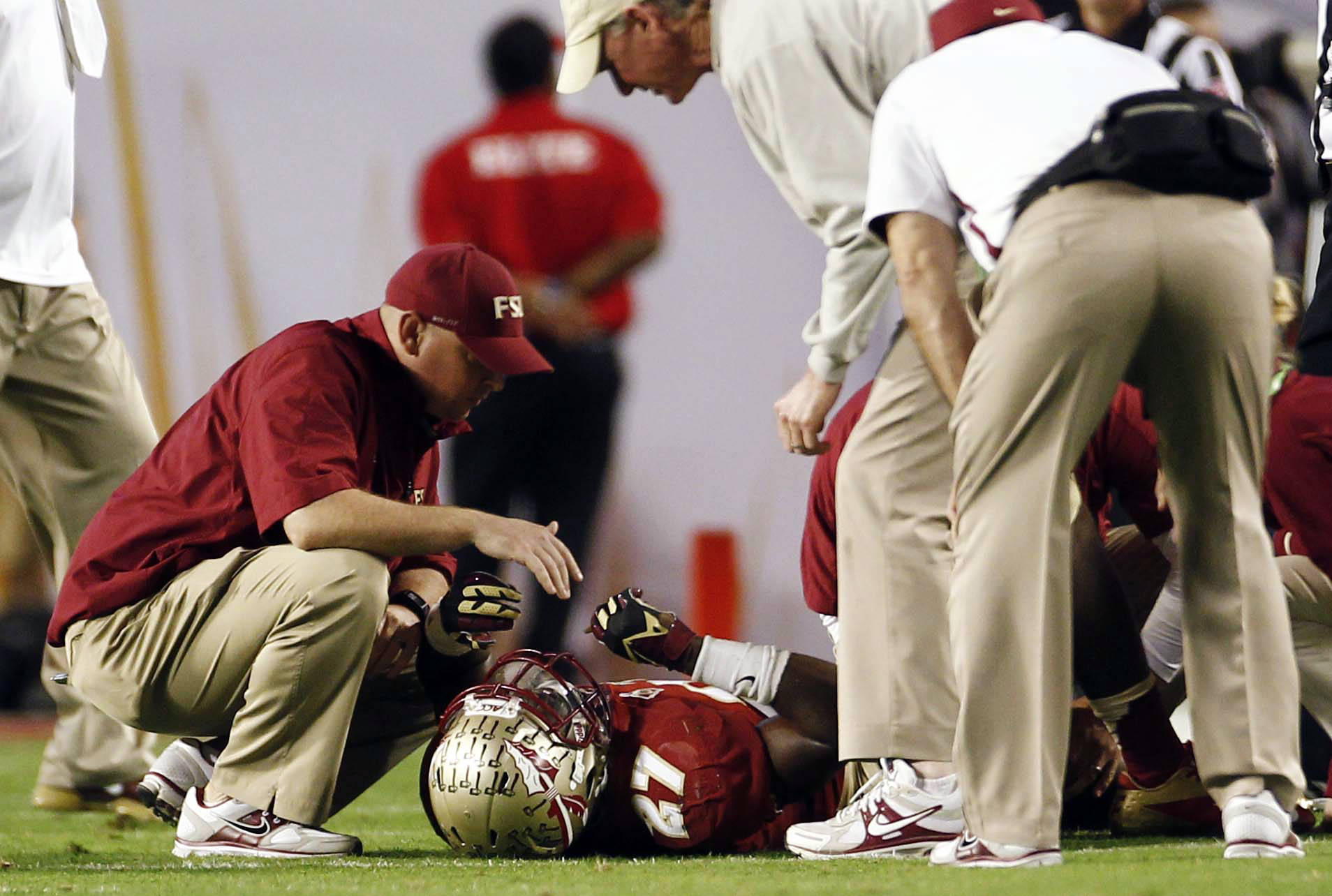Florida State defensive back Xavier Rhodes (27) is tended to by trainers on the field during the second half of the Orange Bowl NCAA college football game against Northern Illinois, Tuesday, Jan. 1, 2013, in Miami. (AP Photo/J Pat Carter)