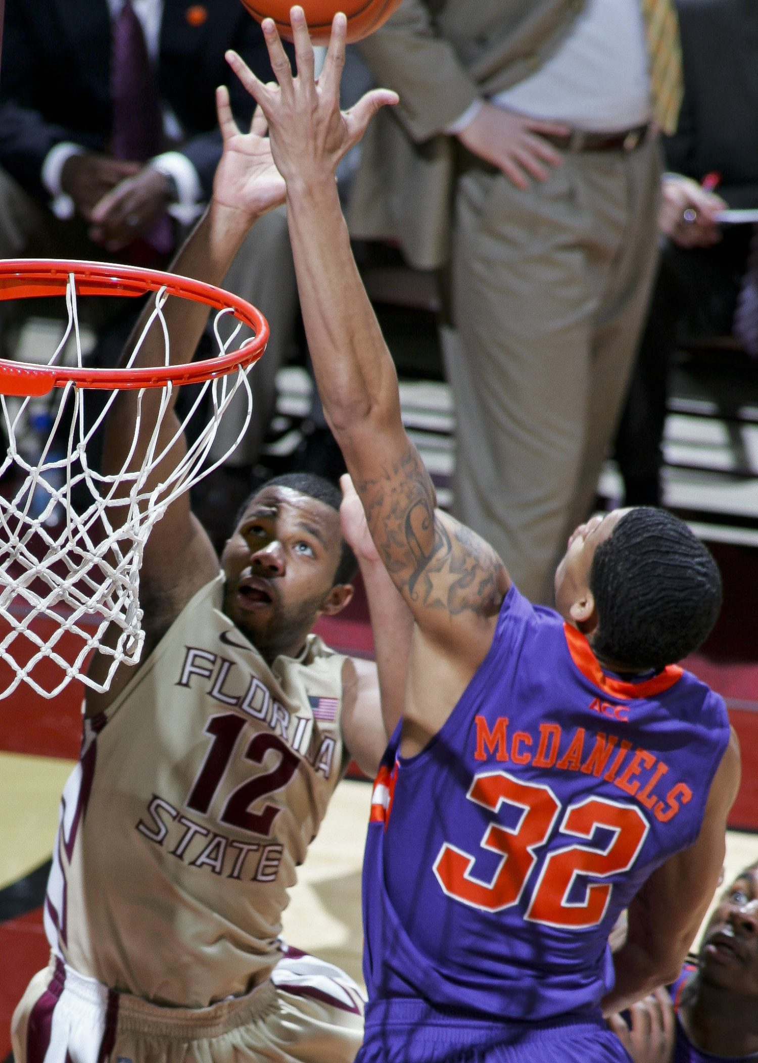 Florida State's Jeff Peterson (12) goes for a layup against Clemson guard K.J. McDaniels (32) in the first half. (AP Photo/Phil Sears)