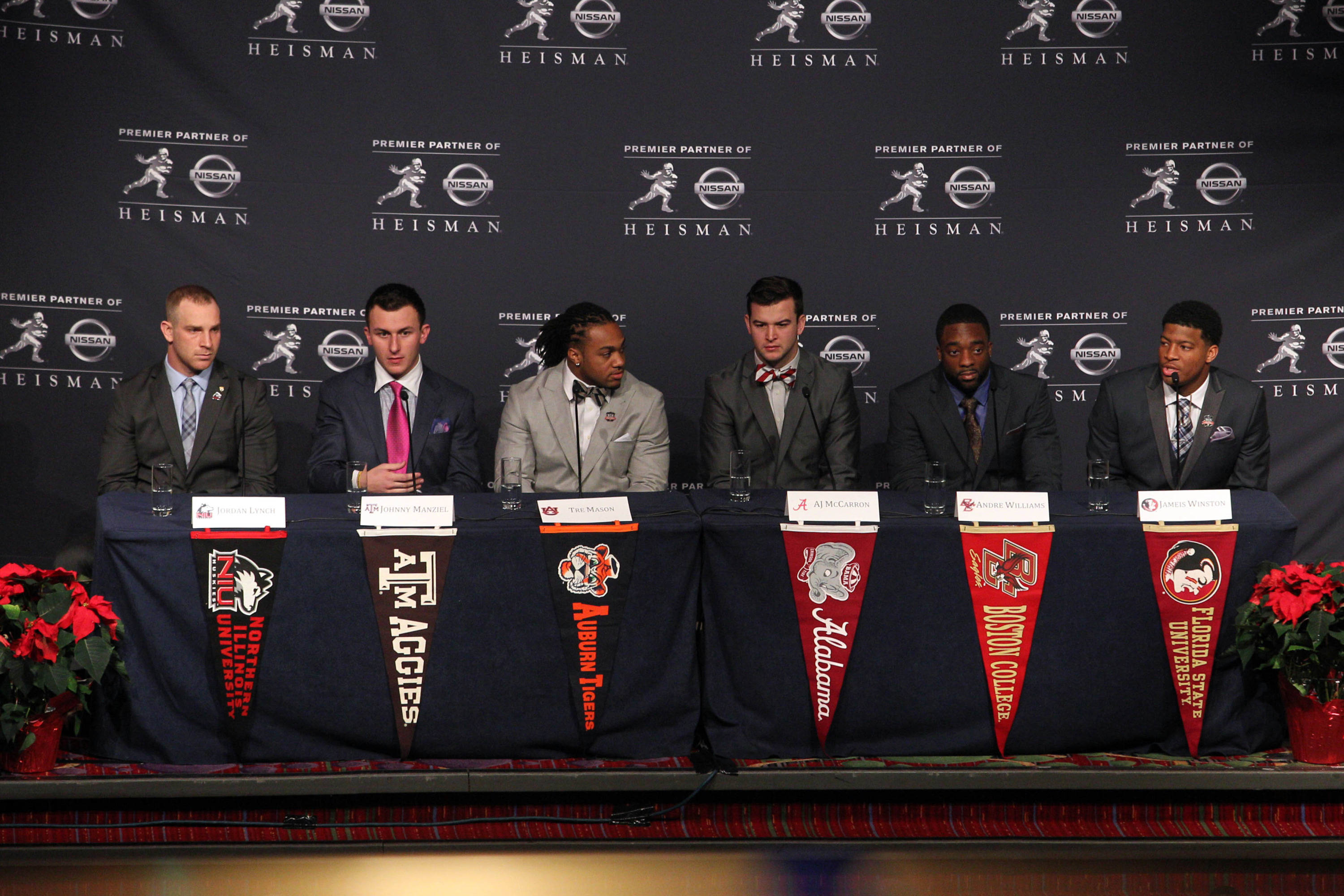 Dec 14, 2013; New York, NY, USA; (From left to right) Nothern Illinois Huskies quarterback Jordan Lynch, and Texas A&M Aggies quarterback Johnny Manziel, and Auburn Tigers running back Tre Mason, and Alabama Crimson Tide quarterback AJ McCarron, and Boston College Eagles running back Andre Williams, and Florida State Seminoles quarterback Jameis Winston talk to the media during a press conference before the announcement of the 2013 Heisman Trophy winner at the New York Marriott Marquis Times