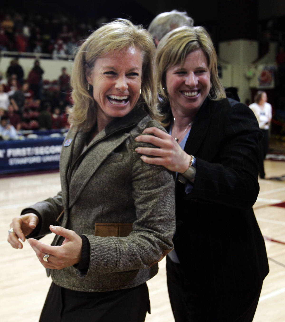 Florida State head coach Sue Semrau, left, and associate head coach Cori Close, right, celebrate after upsetting Stanford 68-61 in their second-round game in the NCAA women's basketball tournament in Stanford, Calif., Monday, March 19, 2007. (AP Photo/Paul Sakuma)