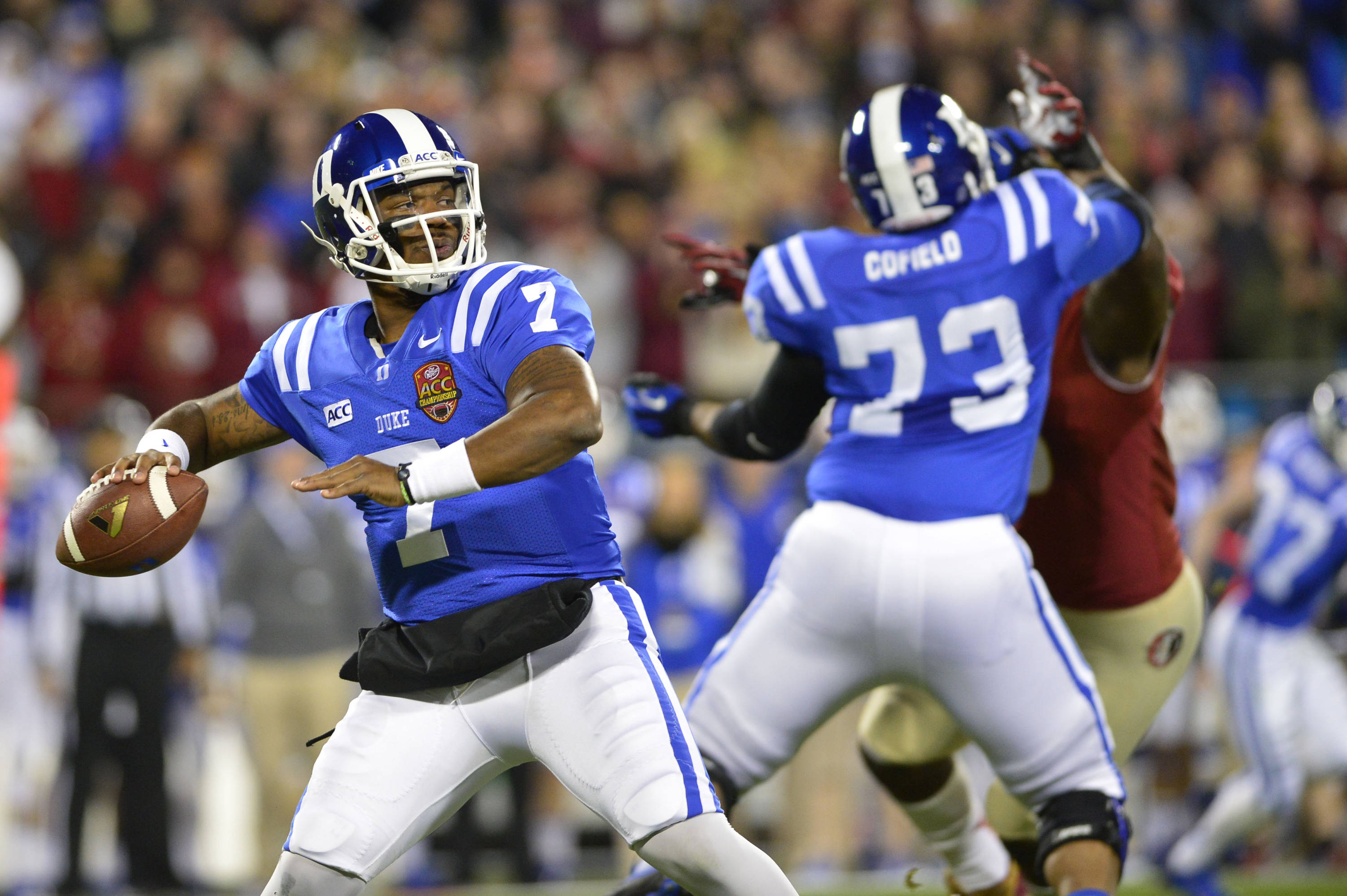 Dec 7, 2013; Charlotte, NC, USA; Duke Blue Devils quarterback Anthony Boone (7) passes the ball as offensive tackle Takoby Cofield (73) blocks in the first quarter at Bank of America Stadium. Mandatory Credit: Bob Donnan-USA TODAY Sports