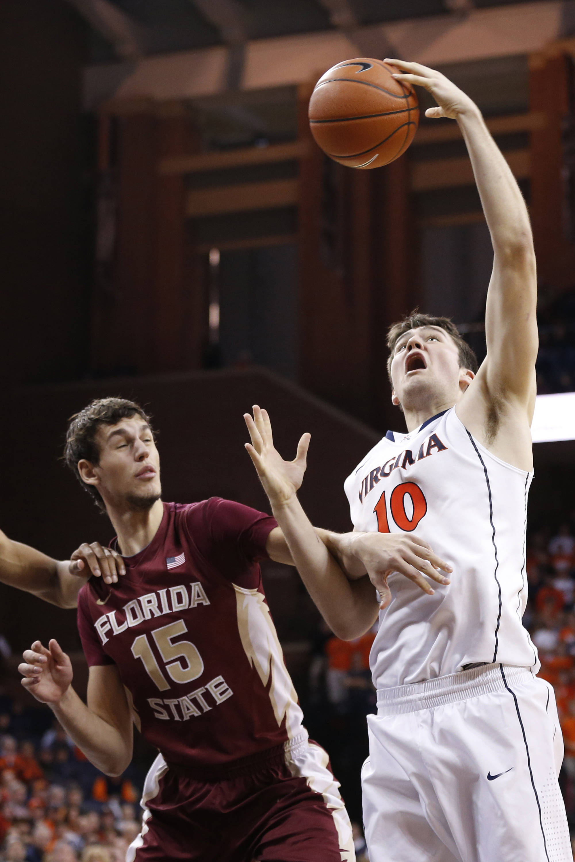 Jan 18, 2014; Charlottesville, VA, USA; Virginia Cavaliers forward/center Mike Tobey (10) grabs the ball in front of Florida State Seminoles center Boris Bojanovsky (15) in the second half at John Paul Jones Arena. The Cavaliers won 78-66. Mandatory Credit: Geoff Burke-USA TODAY Sports