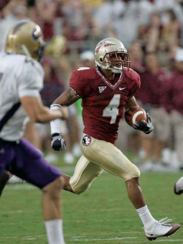 Florida State defensive back Tony Carter returns a punt for a touchdown against Western Carolina during the first quarter