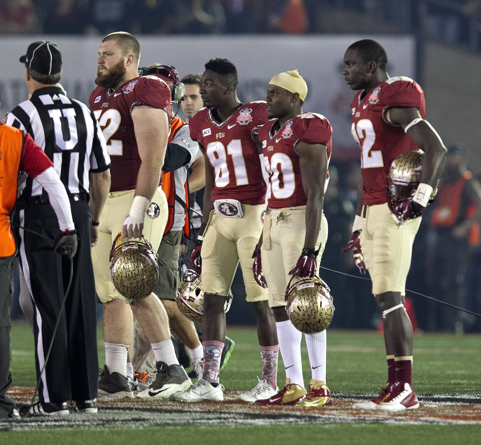 Captains Bryan Stork (52), Kenny Shaw (81), Lamarcus Joyner (20) and Telvin Smith (22) head out for the coin toss, BCS Championship, FSU vs Auburn, Rose Bowl, Pasadena, CA,  1-06-14,  (Photo by Steve Musco)
