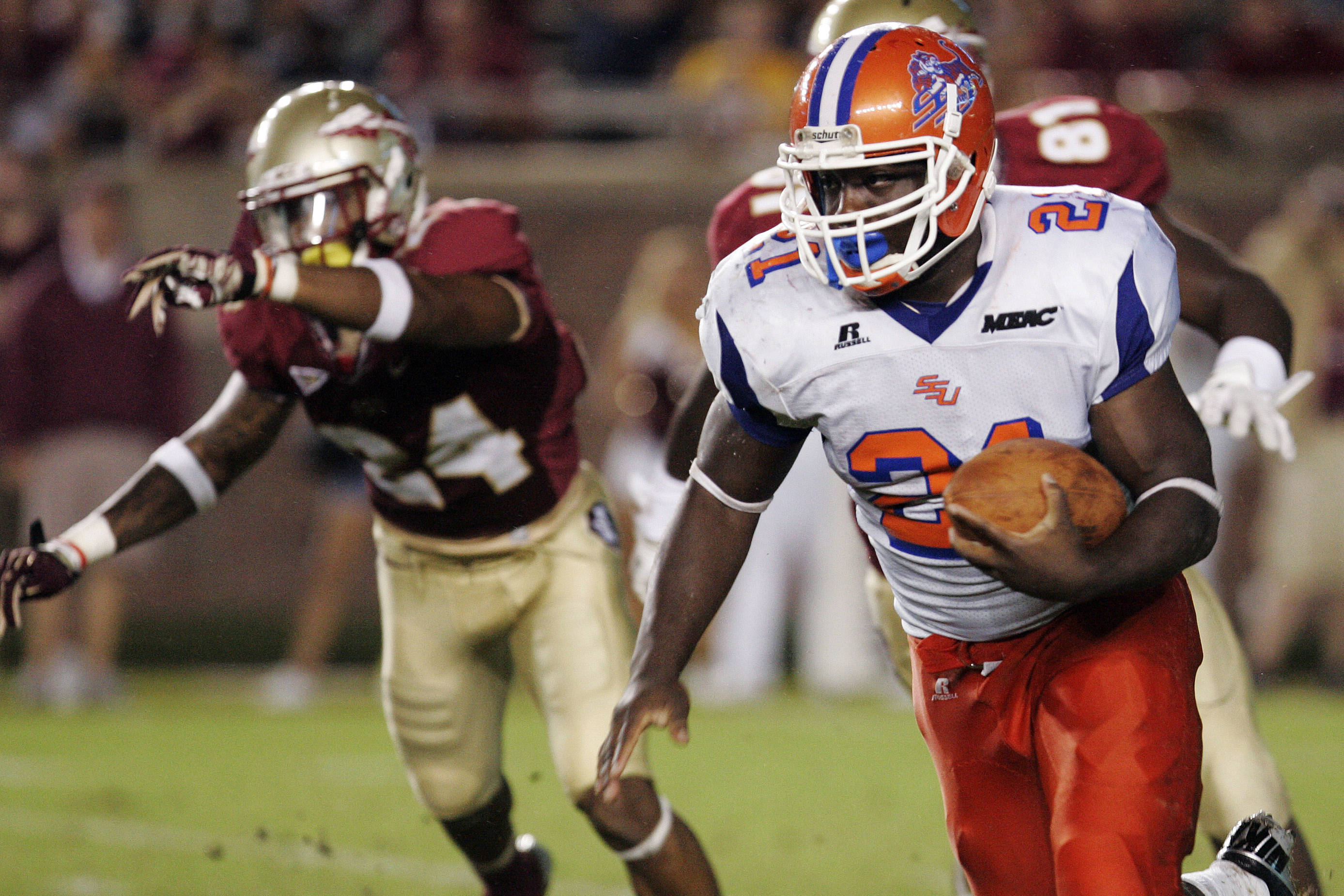Savannah State's Sheldon Barnes runs against Florida State at the end of the second quarter. (AP Photo/Steve Cannon)