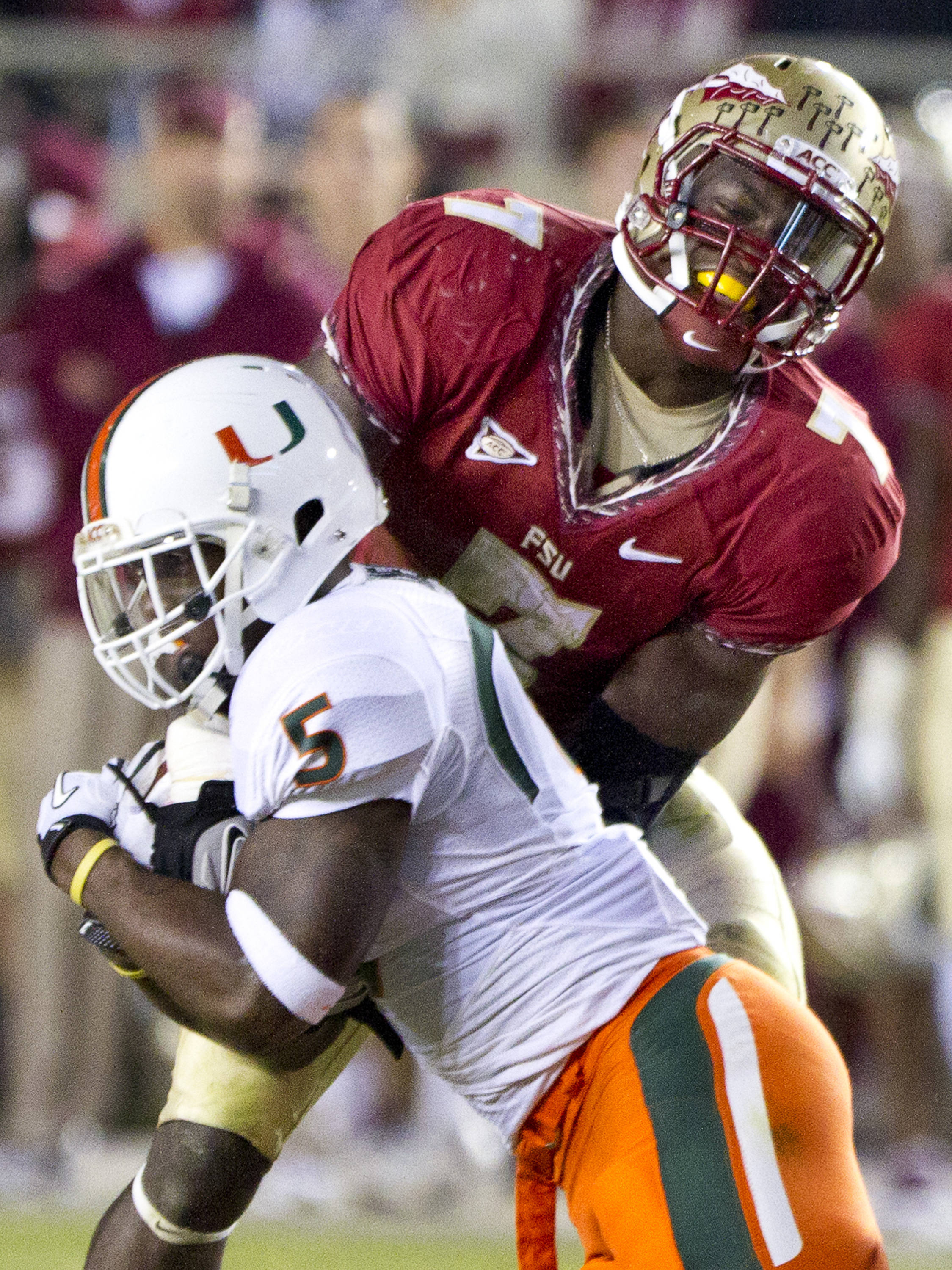 Christian Jones (7) attempts to strip the ball from a Miami player during the football game against Miami on November 12, 2011.
