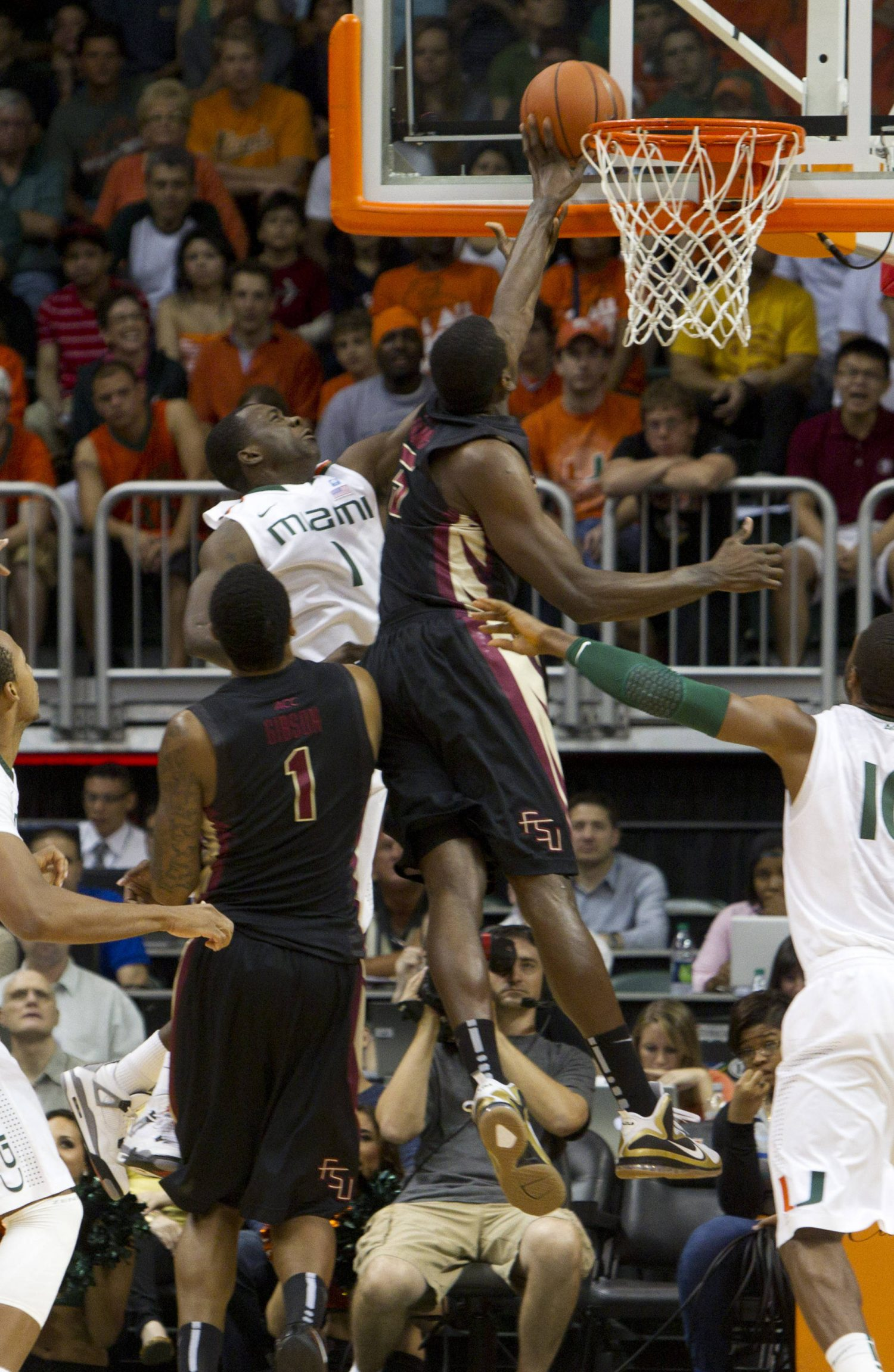 Florida State's Bernard James (5) blocks a shot by Miami's Durand Scott (1) during the first half of an NCAA college basketball game in Coral Gables, Fla., Sunday, Feb. 26, 2012. (AP Photo/J Pat Carter)