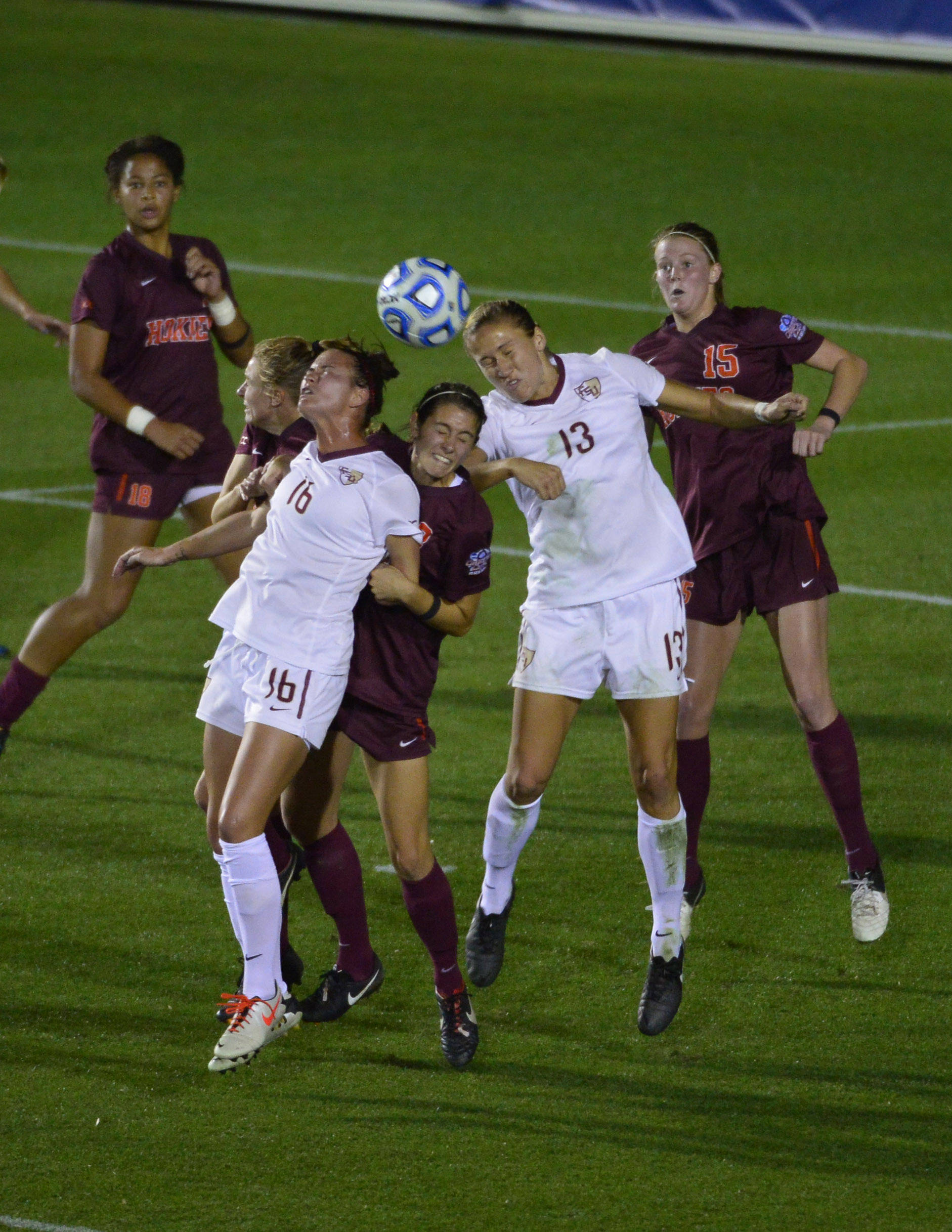 Dec 6, 2013; Cary, NC, USA; Florida State Seminoles defender Carson Pickett (16) and defender Kristin Grubka (13) and Virginia Tech Hokies midfielder Candace Cephers (18) and defender Jodie Zelenky (6) and defender Danielle King (8) and midfielder Ashley Meier (15) fight for the ball in the second half. The Seminoles defeated the Hokies 3-2 at WakeMed Soccer Park. Mandatory Credit: Bob Donnan-USA TODAY Sports