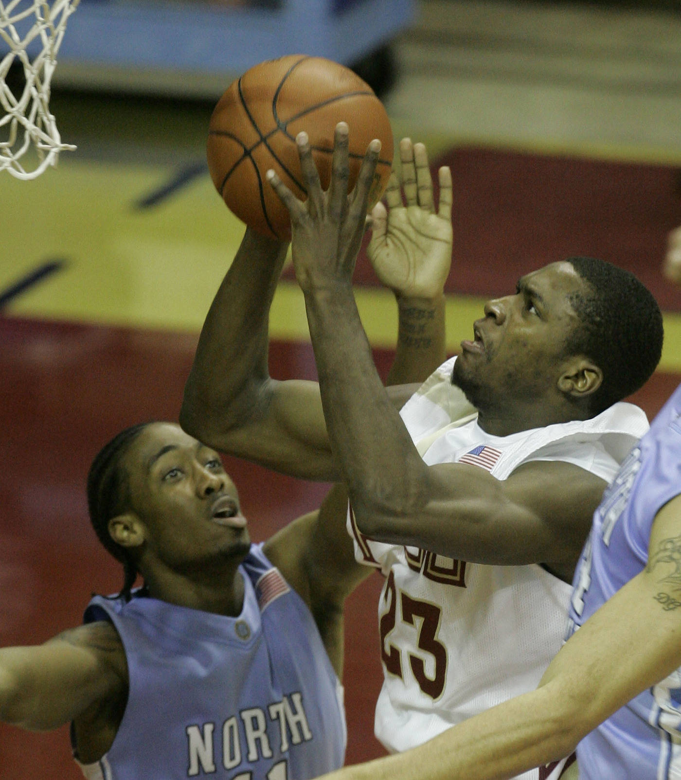 Florida State's Toney Douglas (23), right, drives for two first-half points as North Carolina's Quentin Thomas, left, attempts to defend (AP Photo)