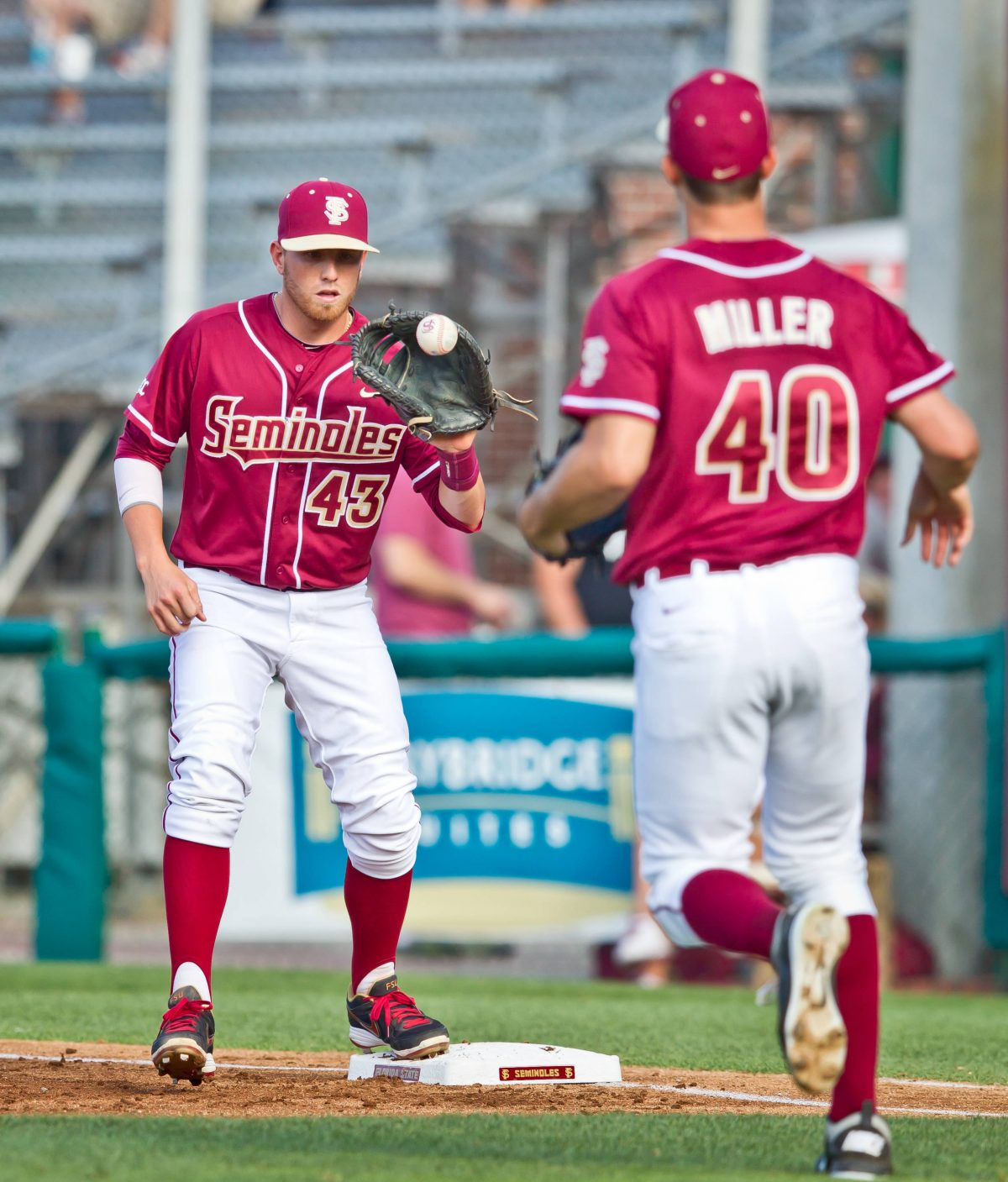 Peter Miller tosses to Casey Smit for the first out of the game.