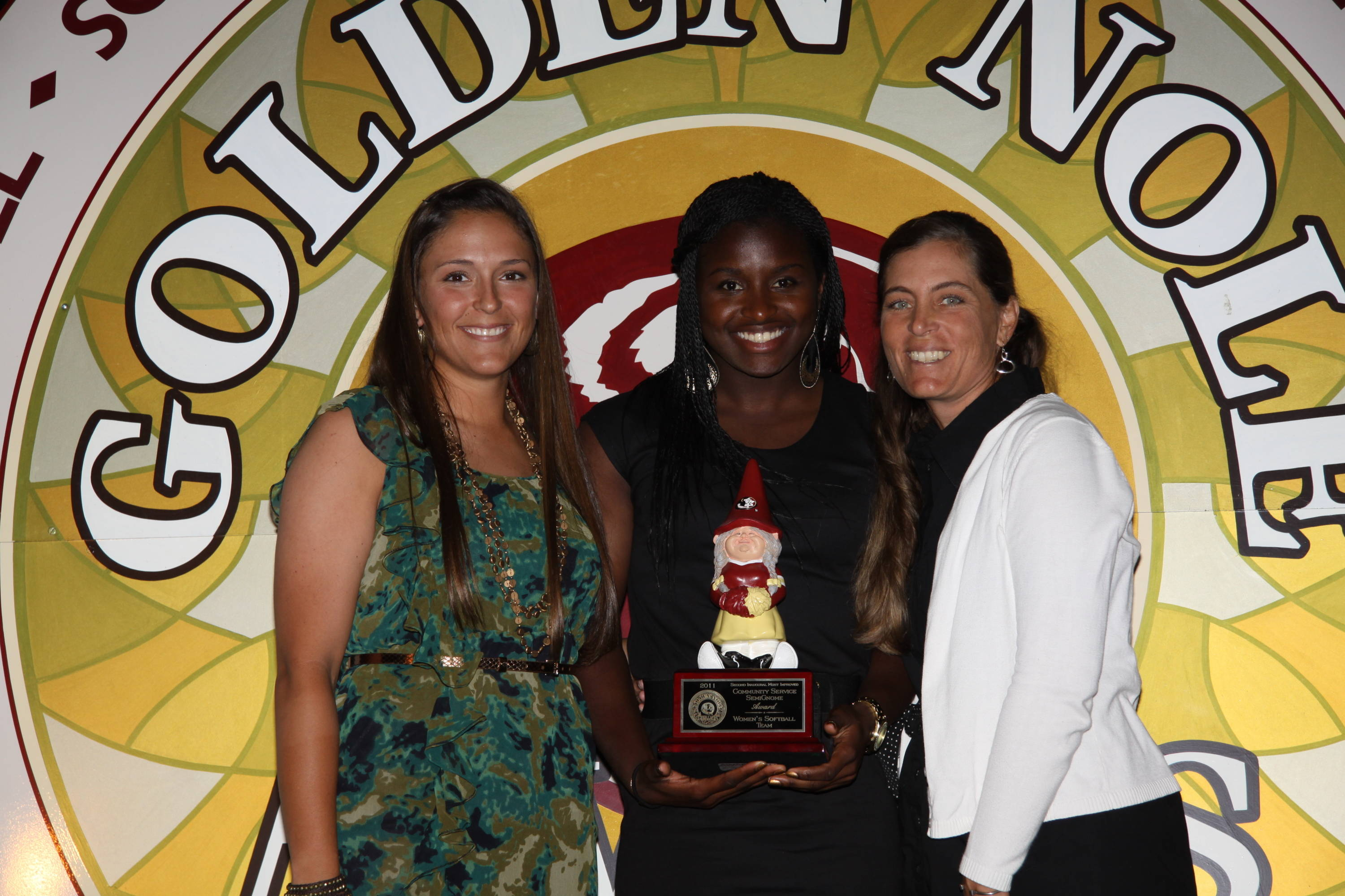 Ashley Stager, Morgan Bullock and head coach Lonni Alameda accept the second annual SemiGnome Award, recognizing the greatest improvement by a team in community service