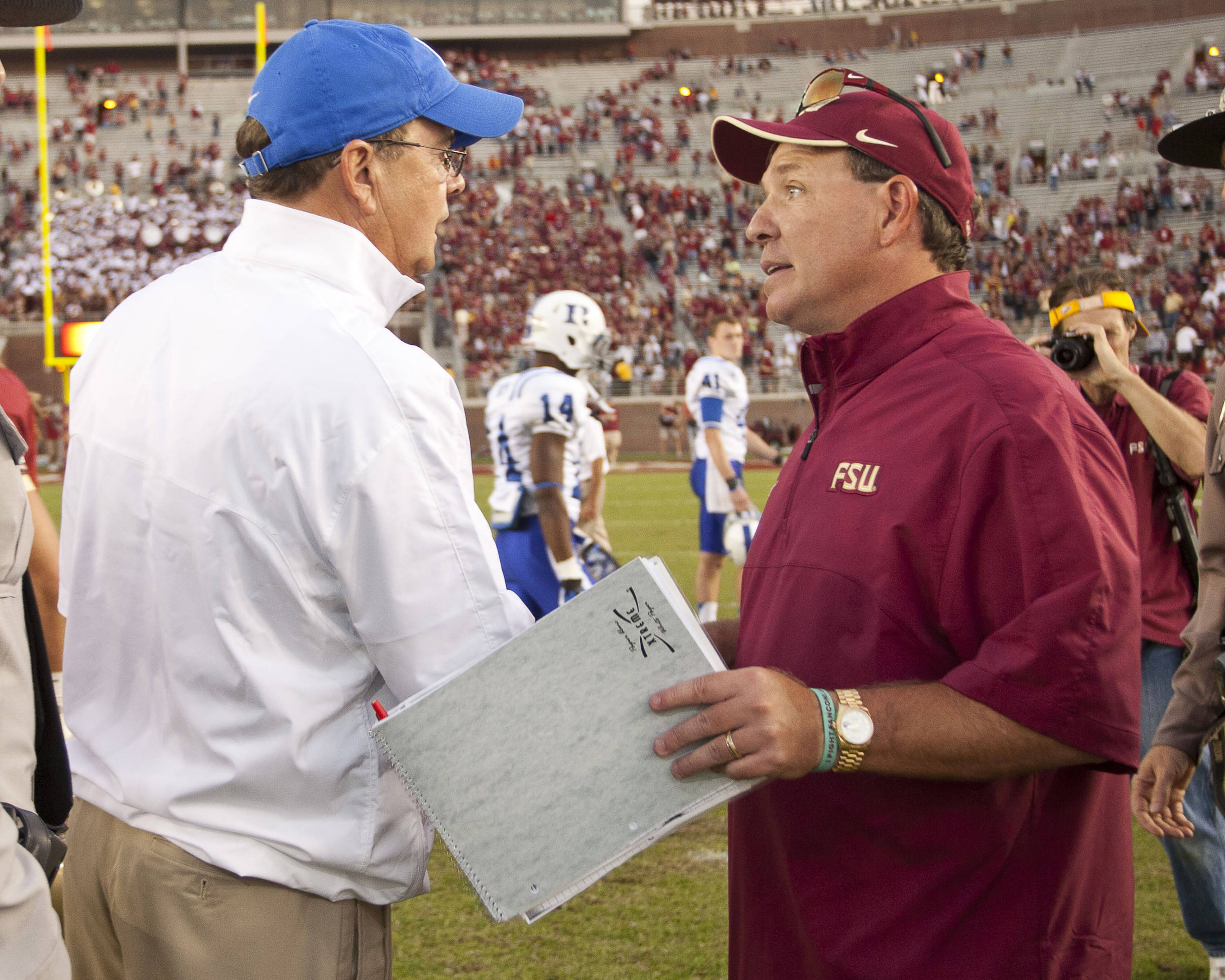 Jimbo Fisher shakes hands with Duke head coach David Cutcliffe after FSU's 48-7 victory over Duke on October 27, 2012 in Tallahassee, Fla.