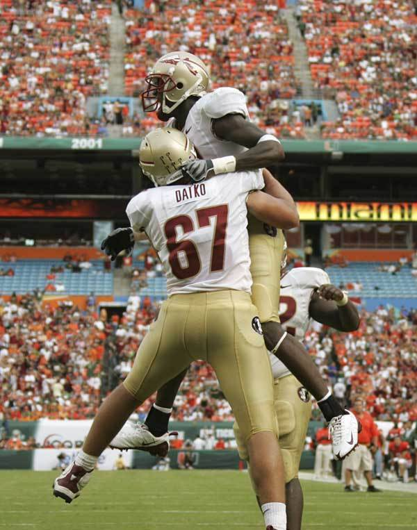 Florida State's Andrew Datko (67) celebrates with wide reciever Greg Carr after Carr scored a touchdown in the first half.