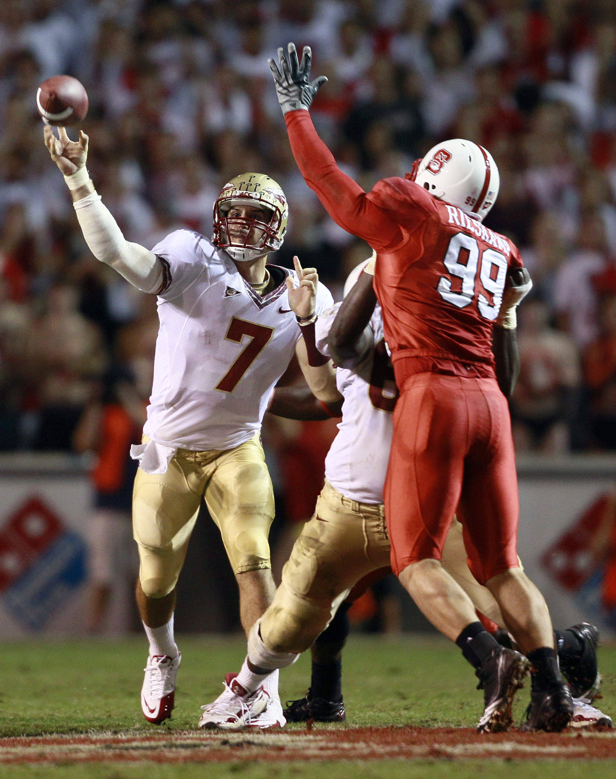 Florida State quarterback Christian Ponder (7) passes as North Carolina State's Jeff Rieskamp (99) defends during the first half of an NCAA college football game in Raleigh, N.C., Thursday, Oct. 28, 2010. (AP Photo/Gerry Broome)
