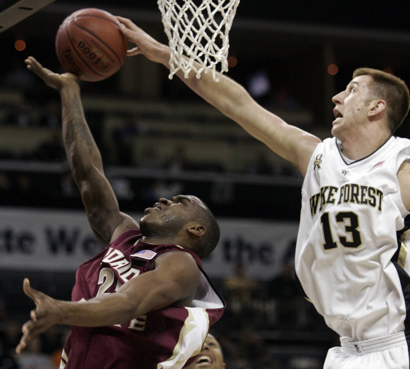 Wake Forest's Chas McFarland blocks the shot of Jason Rich in the first half. (AP Photo/Steve Helber)