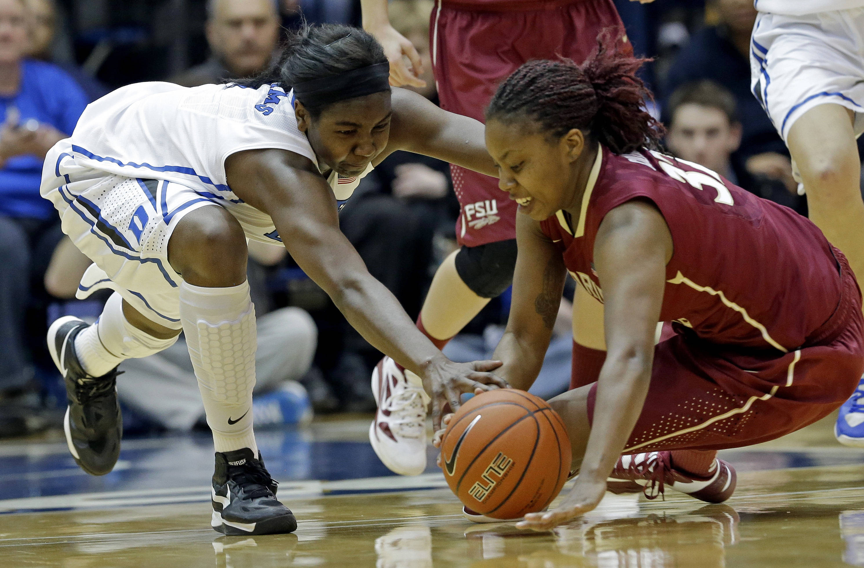 Duke's Elizabeth Williams, left, and Florida State's Lauren Coleman reach for the loose ball during the first half. (AP Photo/Gerry Broome)