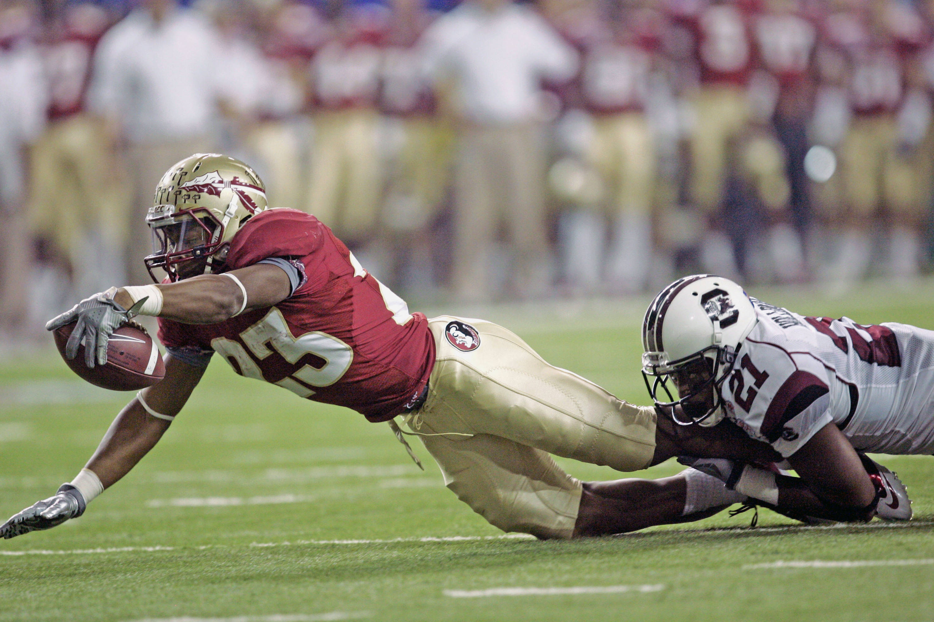 Florida State running back Chris Thompson (23) reaches for extra yardage as South Carolina cornerback Brandan Davis (23) hangs on in the first quarter of the Chick-fil-A Bowl NCAA college football game on Friday, Dec. 31, 2010, in Atlanta. (AP Photo/John Amis)