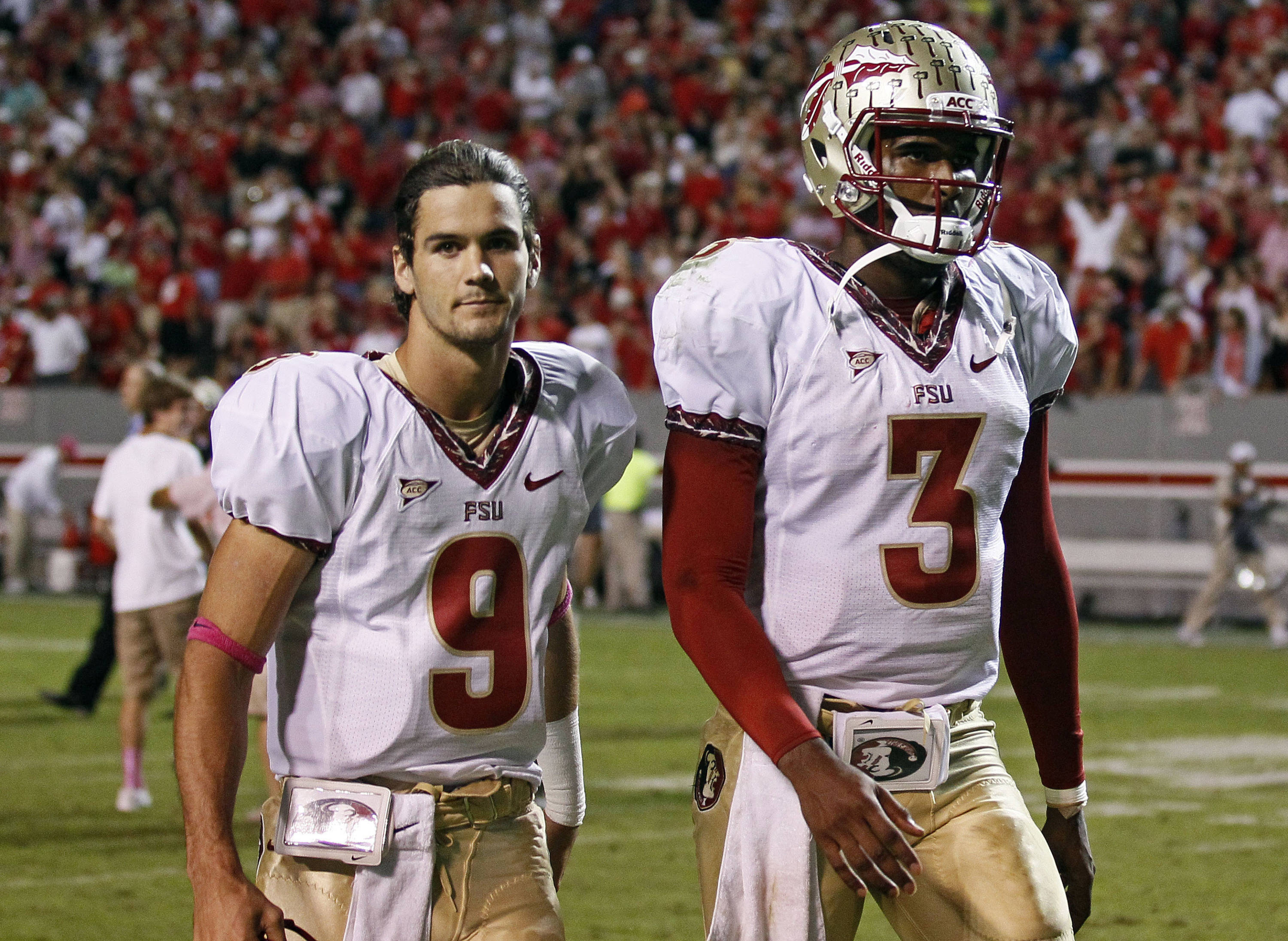 Florida State's Clint Trickett (9) and quarterback EJ Manuel (3) leave the field following Florida State's 17-16 loss to North Carolina State. (AP Photo/Gerry Broome)