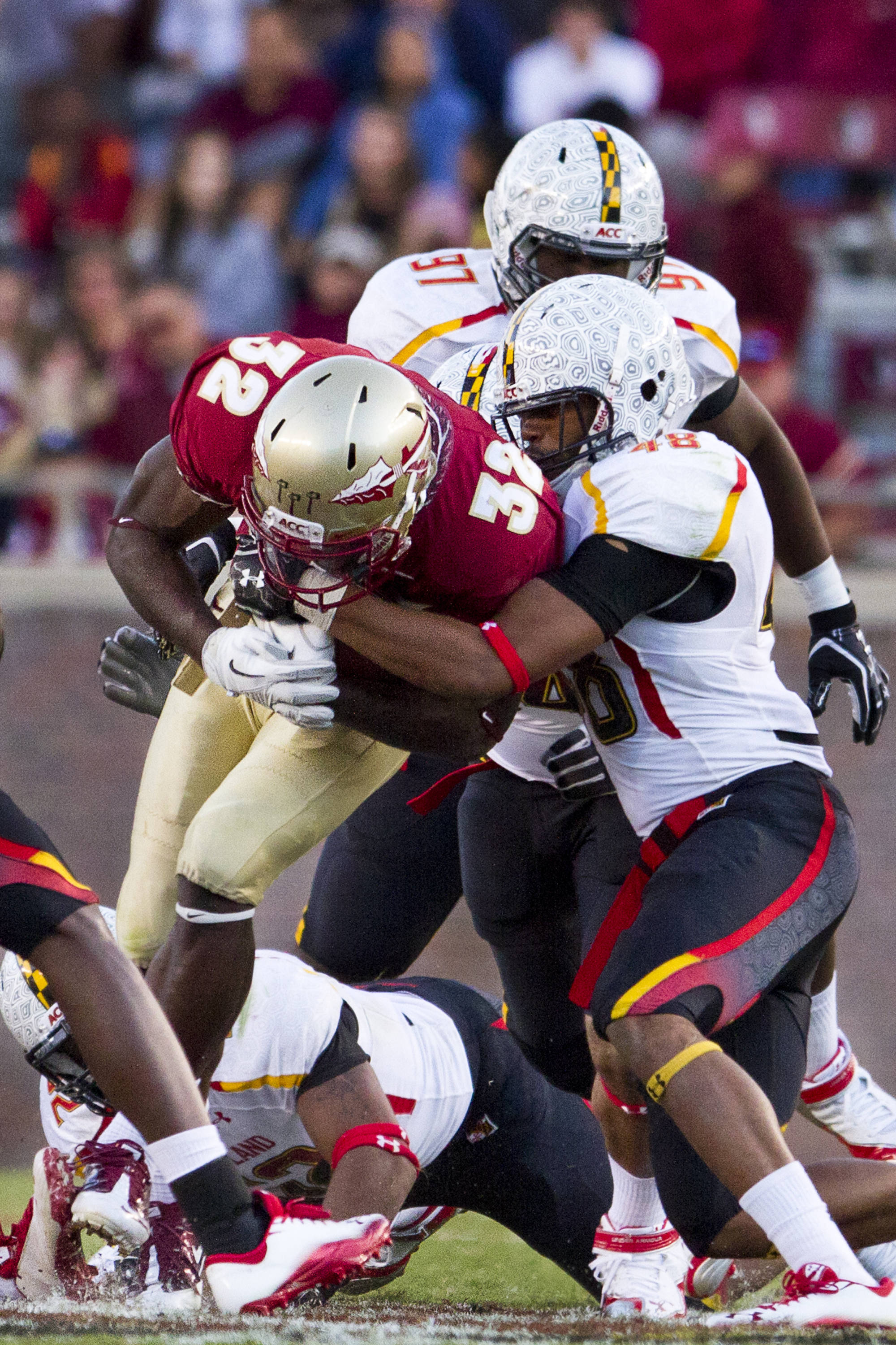 Jr. Wilder James (32) carries the ball and a Maryland defender downfield during the football game against Maryland in Tallahassee, Florida on October 22, 2011.
