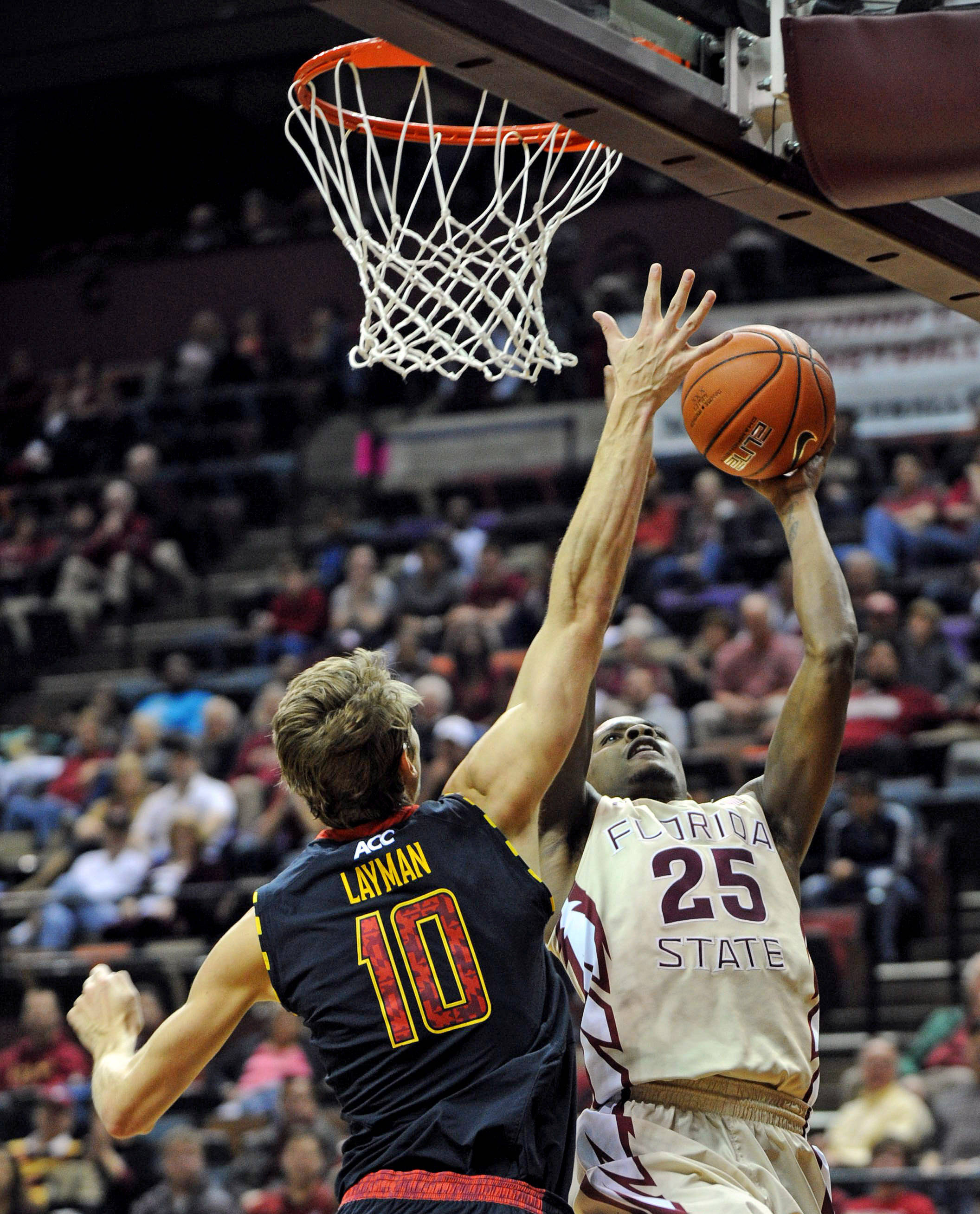 Jan 12, 2014; Tallahassee, FL, USA; Florida State Seminoles guard Aaron Thomas (25) shoots the ball past Maryland Terrapins forward Jake Layman (10) during the first half at Donald L. Tucker Center. Mandatory Credit: Melina Vastola-USA TODAY Sports