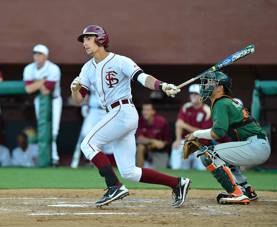 Justin Gonzalez launches the first of two home runs in Friday night's win over Miami.