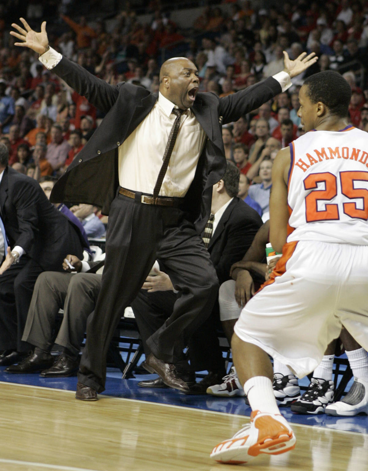 Florida State coach Leonard Hamilton, left, reacts to a play during a first round game at the Men's Atlantic Coast Conference basketball tournament against Clemson in Tampa, Fla., Thursday, March 8, 2007. Florida State edged Clemsom 67-66. (AP Photo/David J. Phillip)