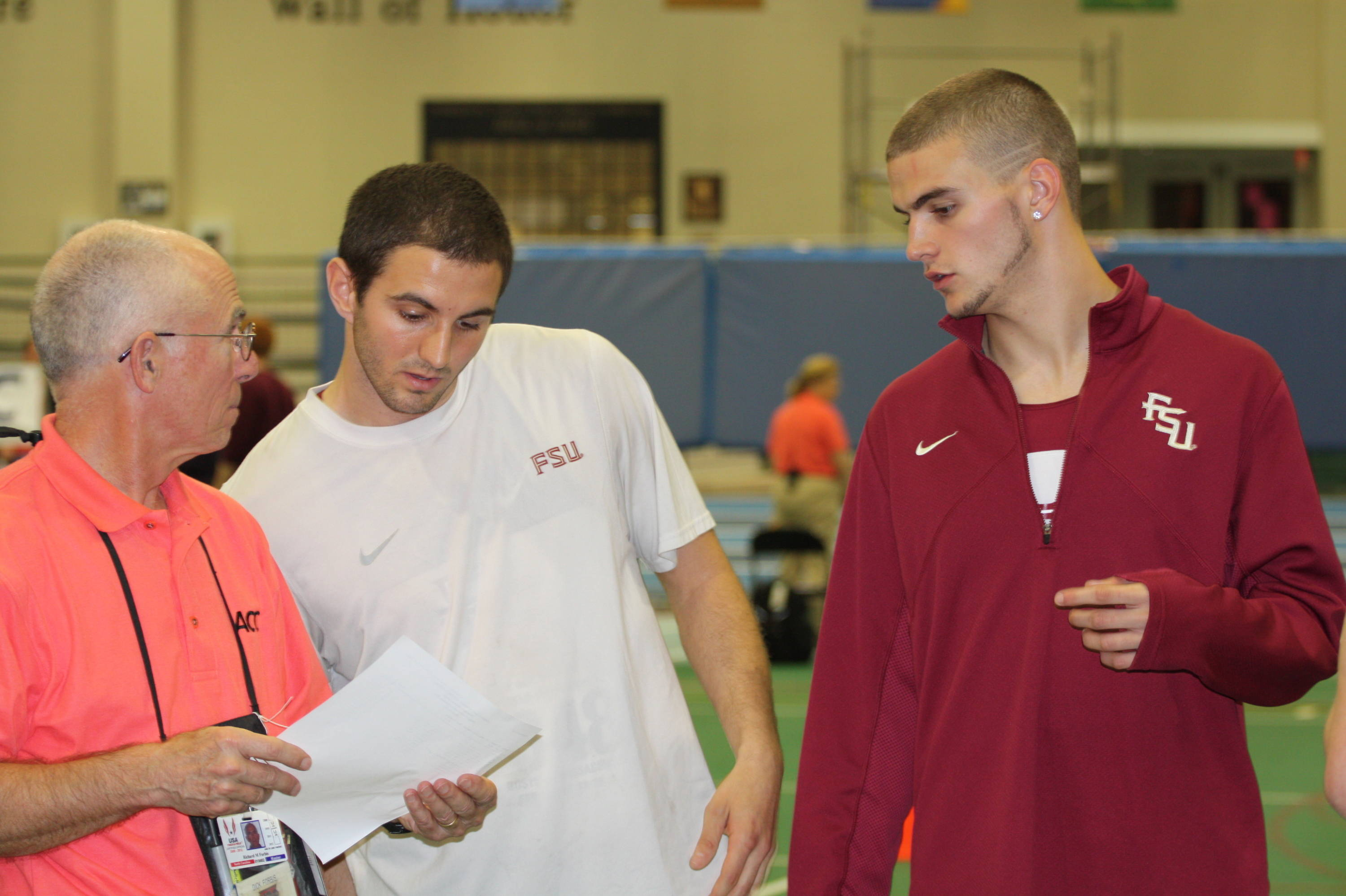Seminoles Chris Snow and Daniel Salgado talk to an official before the 1000-meter final of the heptathlon.