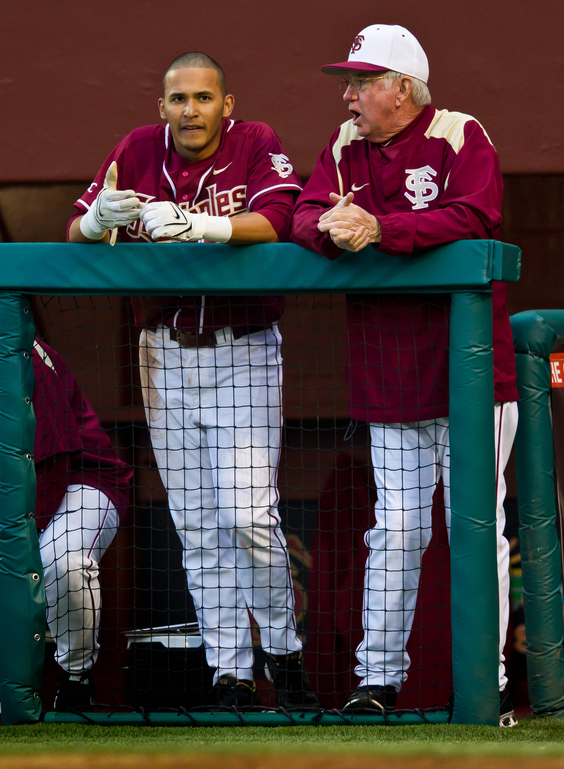 Jose Brizuela talks to head coach Mike Martin