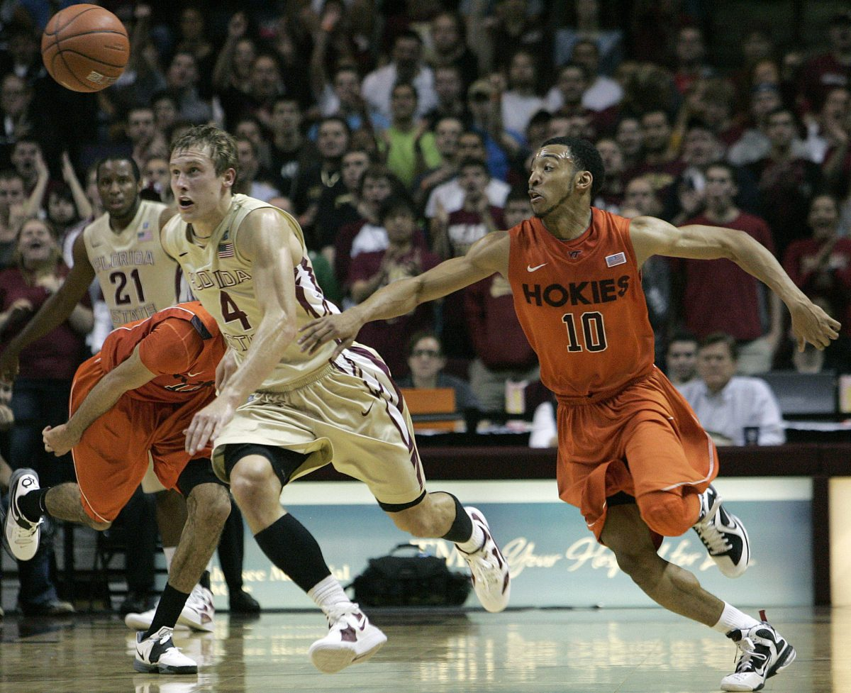 Florida State's Deividas Dulkys (4) and Virginia Tech's Marquis Rankin (10) chase after a loose ball during the second half. (AP Photo/Steve Cannon)