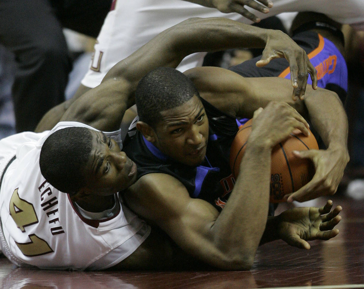 Florida's Al Horford, right, and Florida State's Uche Echefu, left, battle for a loose ball during the second half of a college basketball game, Sunday, Dec. 3, 2006, in Tallahassee, Fla.(AP Photo/Phil Coale)