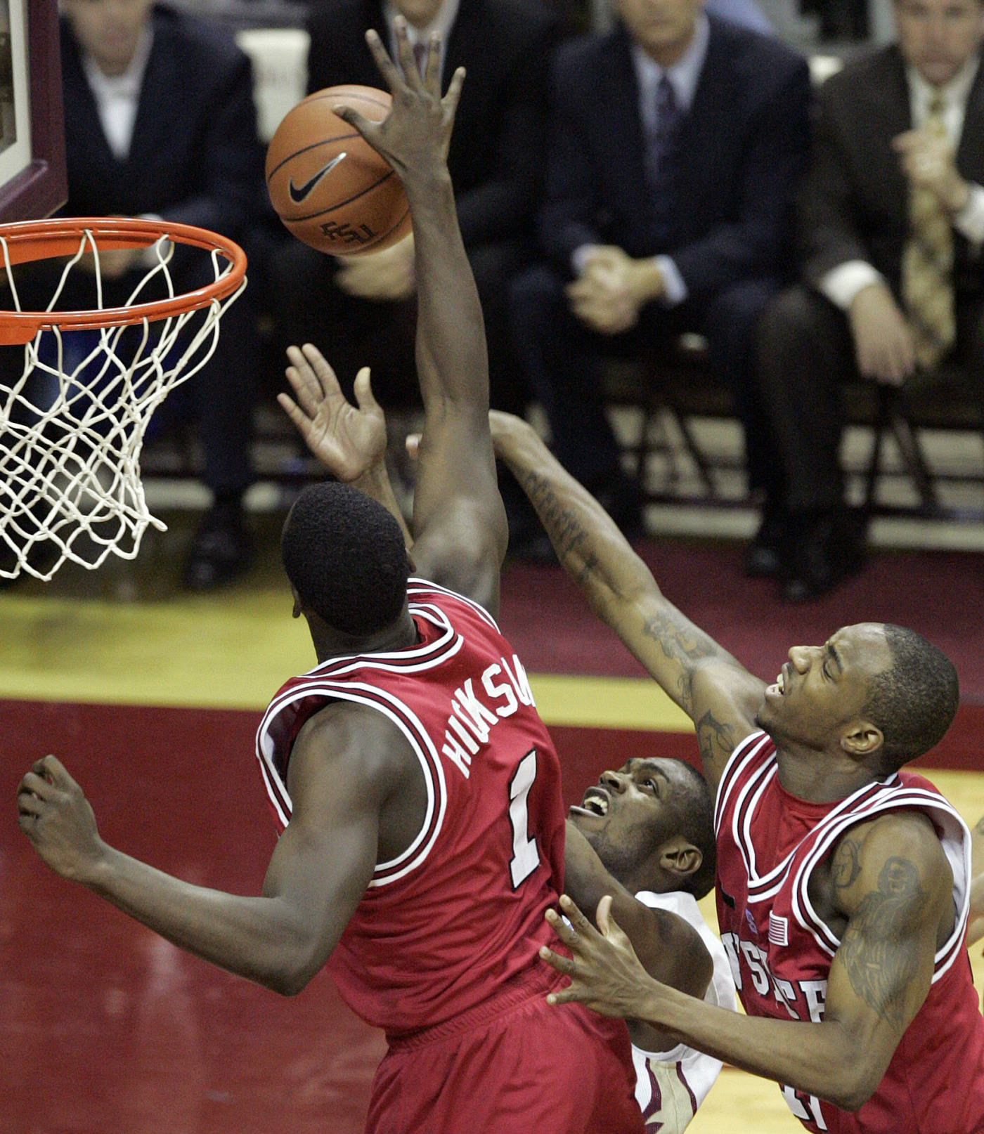 Florida State's Jason Rich is sandwiched by the defense of North Carolina State's J J Hickson, left and Gavin Grant in the first half of a college basketball game on Saturday, Jan. 26, 2008 in Tallahassee, Fla.