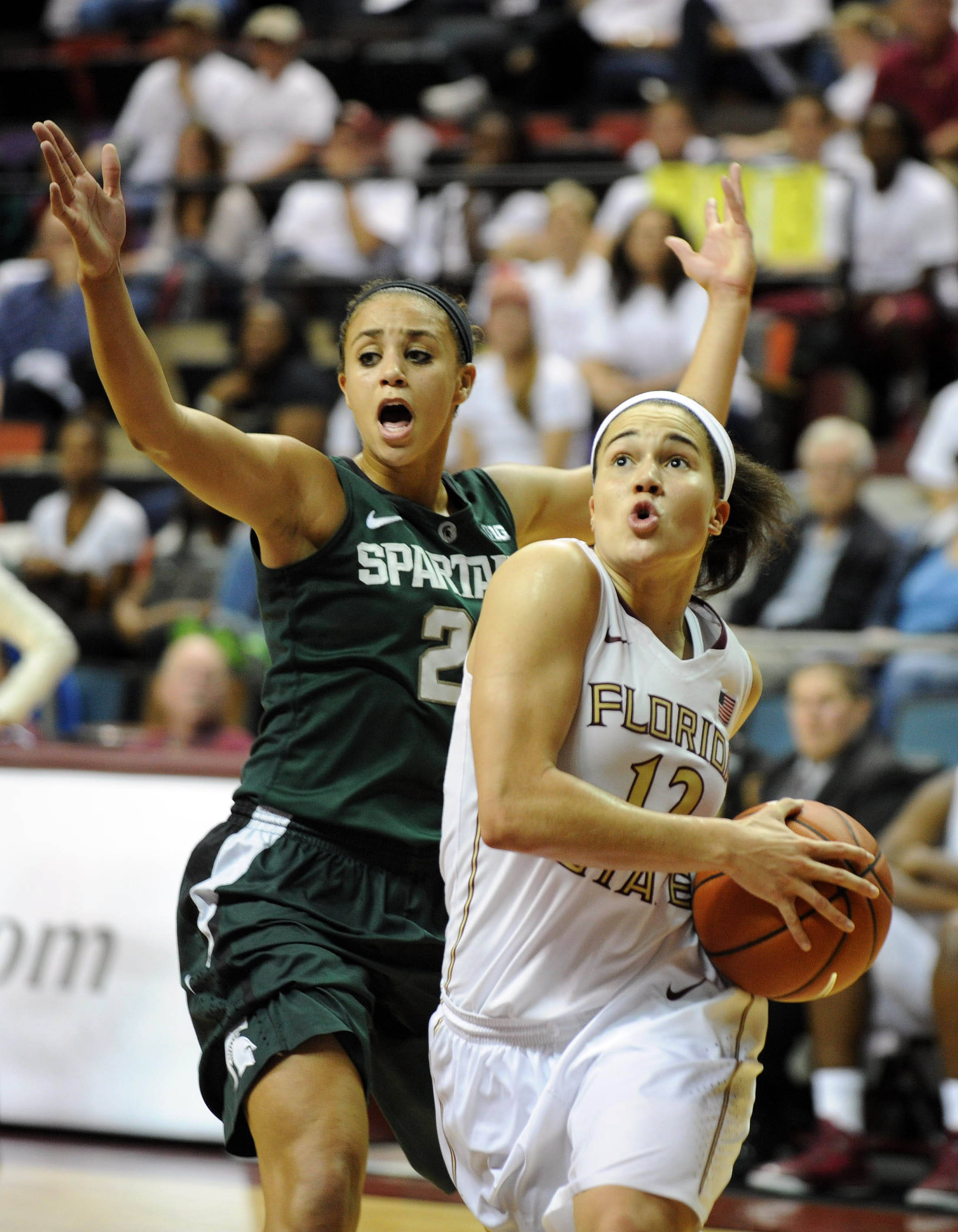 Dec 4, 2013; Tallahassee, FL, USA; Michigan State guard Klarissa Bell (21) tries to defend Florida State Seminoles guard Brittany Brown (12) during the game at the Donald L. Tucker Center (Tallahassee). Mandatory Credit: Melina Vastola-USA TODAY Sports