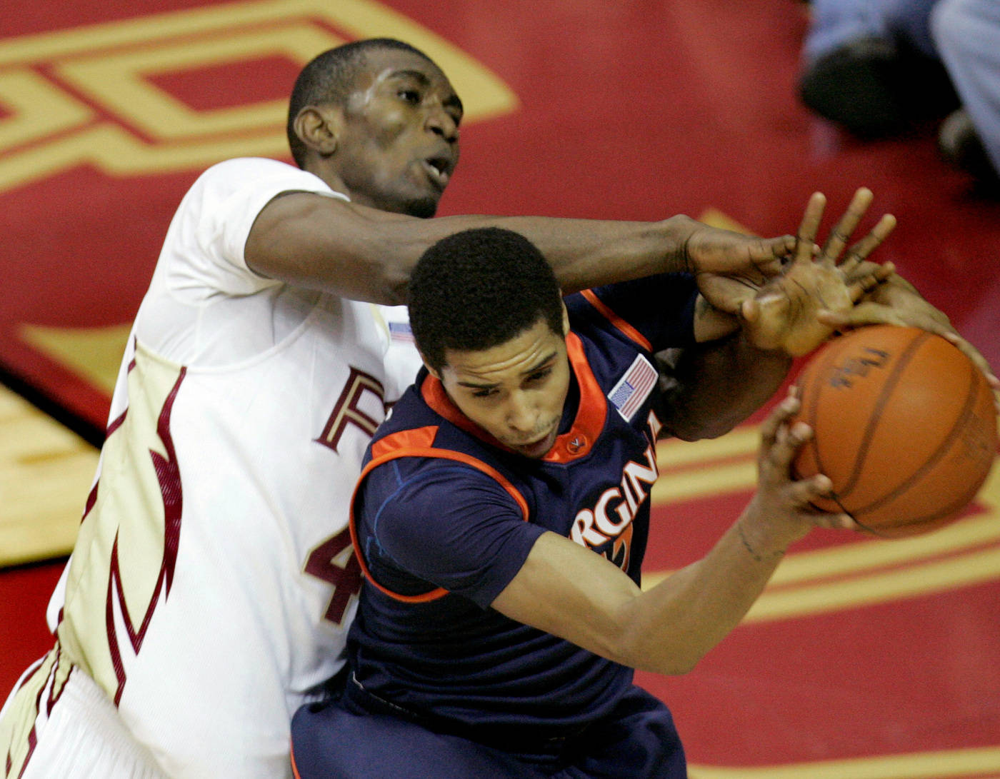 Virginia's Sylven Landesberg, right, is fouled by Florida State's Uche Echefu as he battles for a first-half rebound. (AP Photo/Phil Coale)
