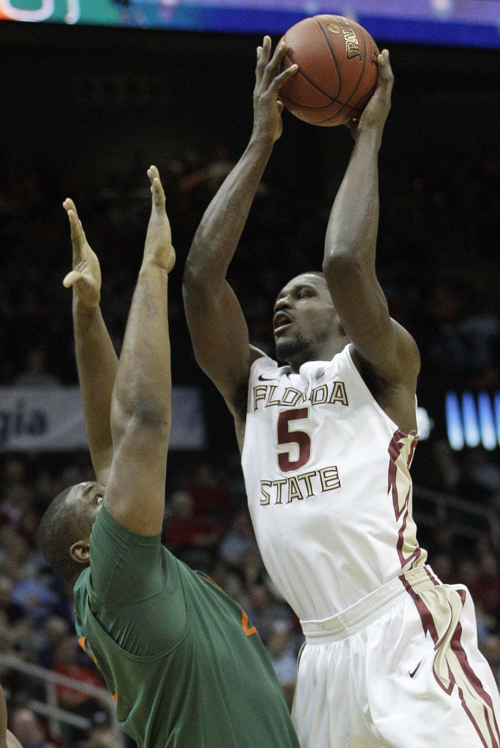 Florida State forward Bernard James (5) works against Miami center Reggie Johnson (42) during the first half of an NCAA college basketball game in the quarterfinals of the Atlantic Coast Conference tournament, Friday, March 9, 2012, in Atlanta. (AP Photo/Chuck Burton)