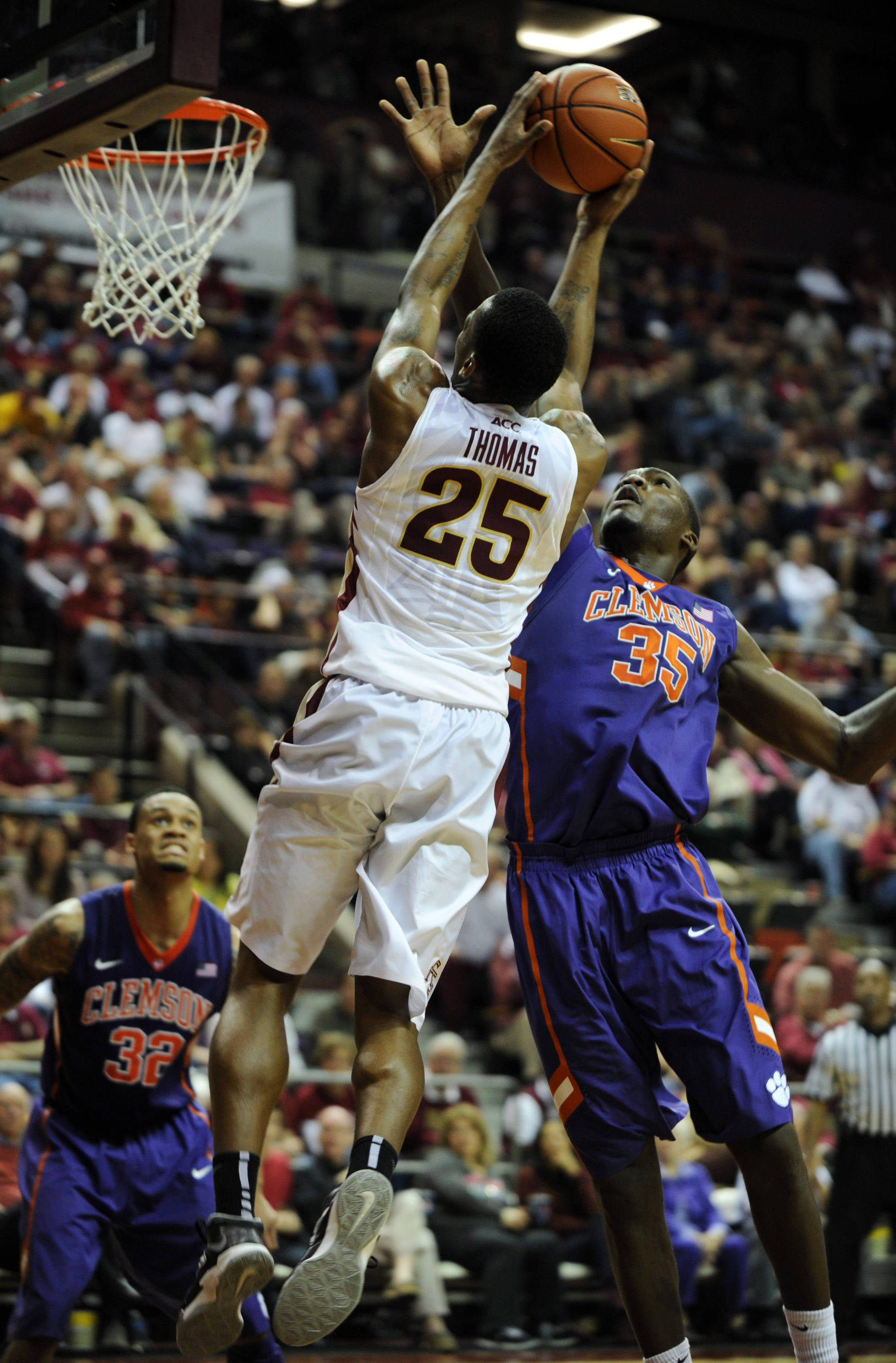 Feb 1, 2014; Tallahassee, FL, USA; Clemson Tigers center Landry Nnoko (35) fouls Florida State Seminoles guard Aaron Thomas (25) during the second half at the Donald L. Tucker Center. Mandatory Credit: Melina Vastola-USA TODAY Sports