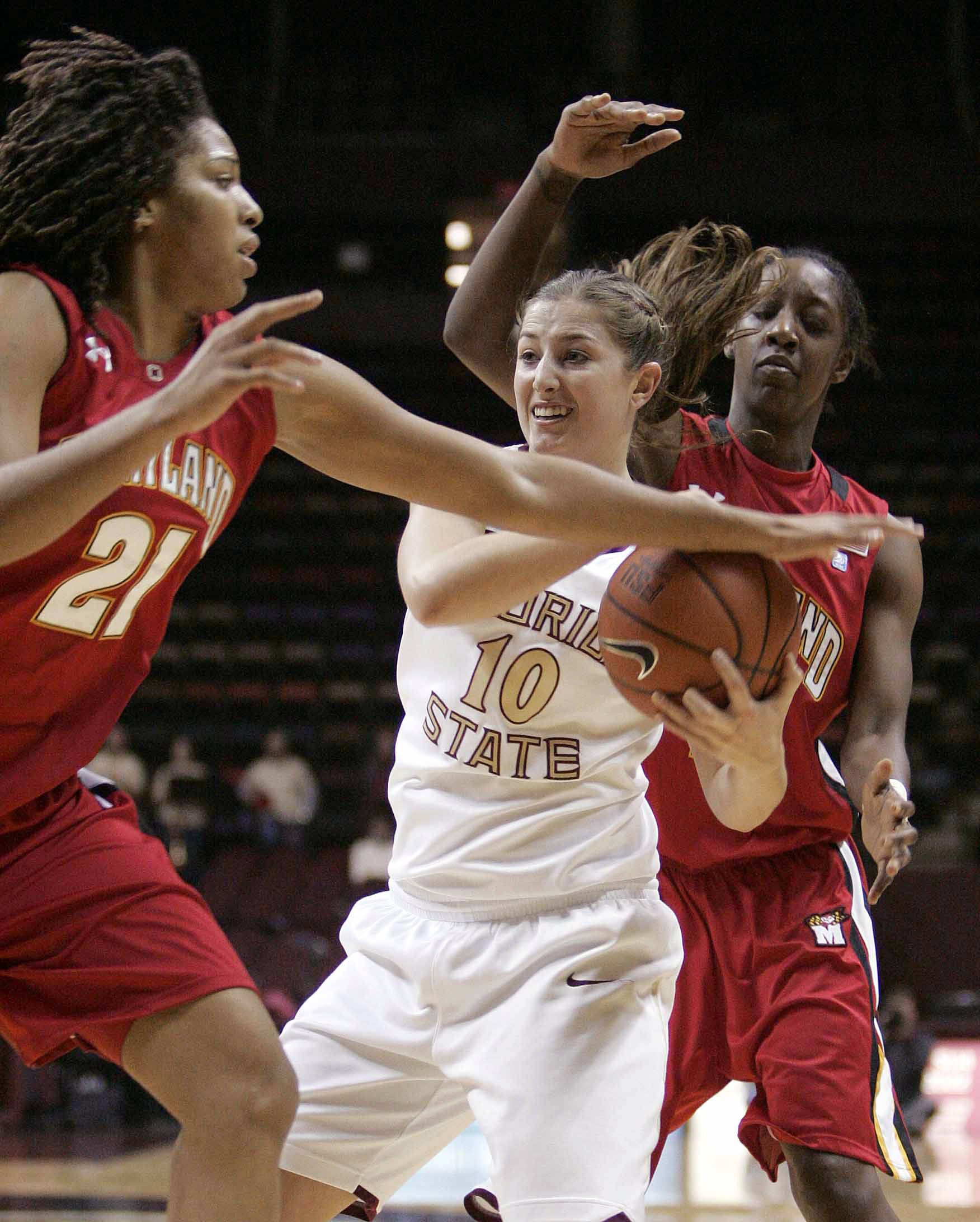 Florida State's Leonor Rodriguez protects the ball from Maryland's Tiana Hawkins, left and Laurin Mincy in the first half of an NCAA college basketball game Monday, Jan. 2, 2012, in Tallahassee, Fla. (AP Photo/Steve Cannon)