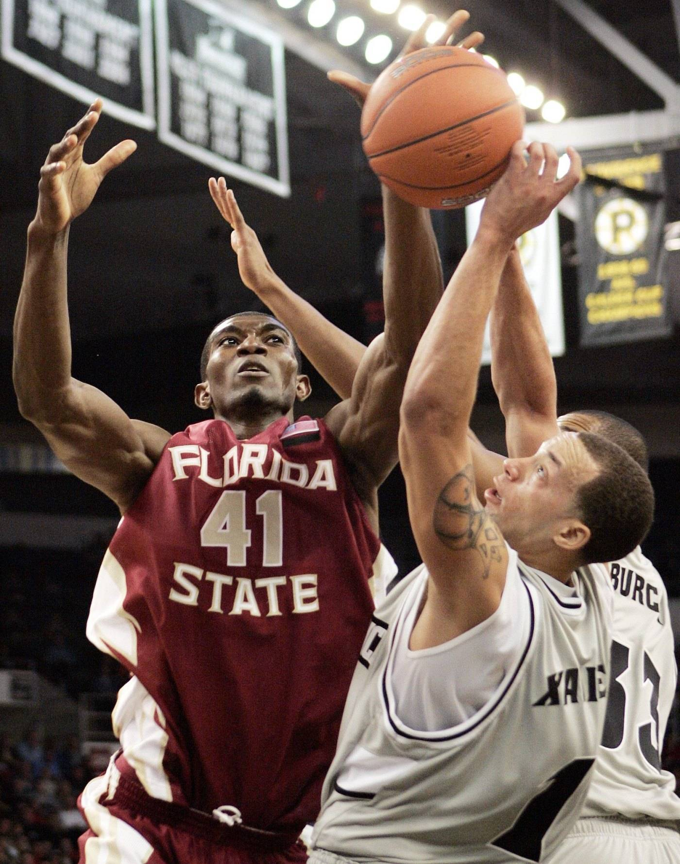 Florida State's Uche Echefu battles Providence's Jeff Xavier for a rebound in the second half.
