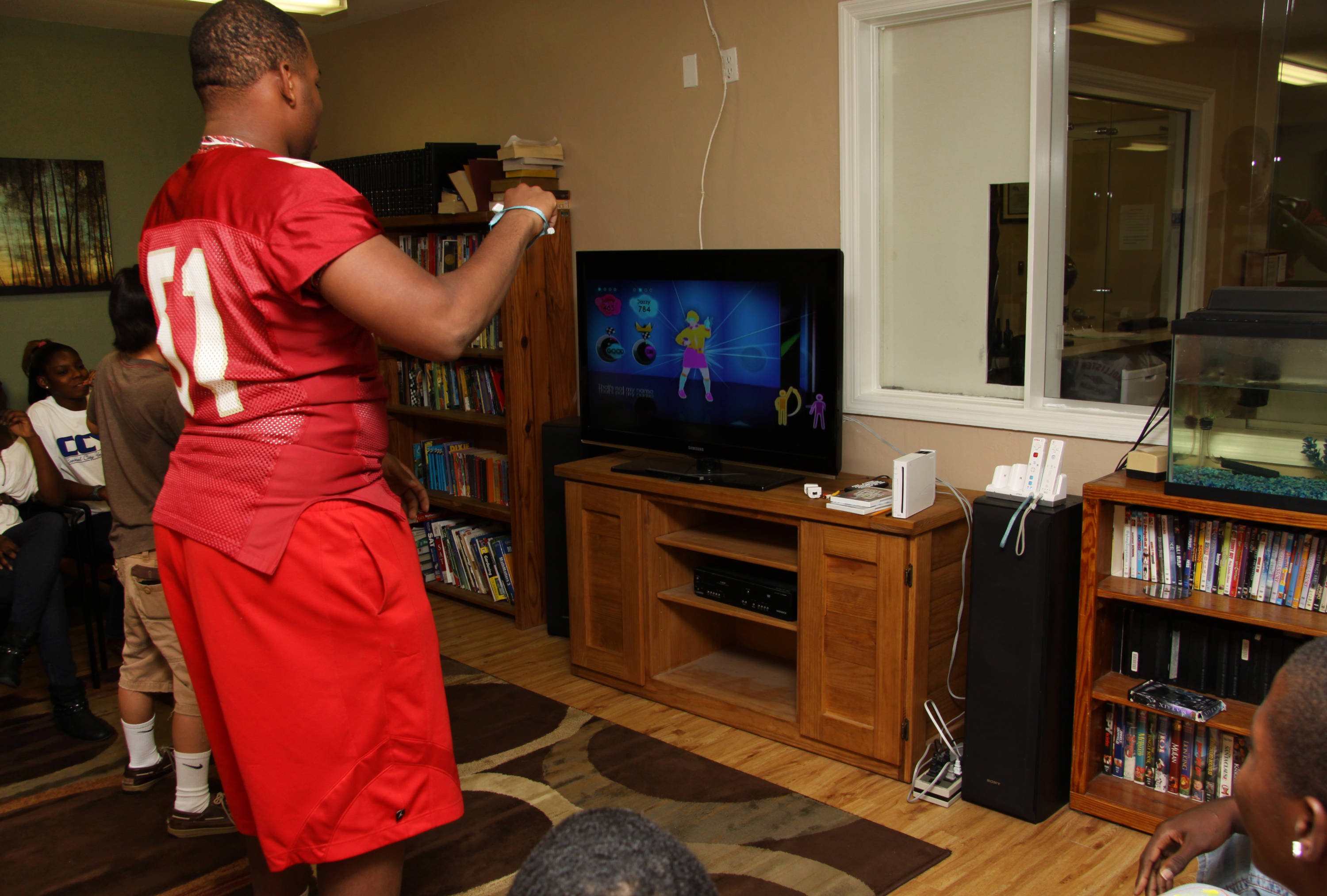 Bobby Hart plays Wii at Capital City Youth Services as part of FSU's Day of Doing