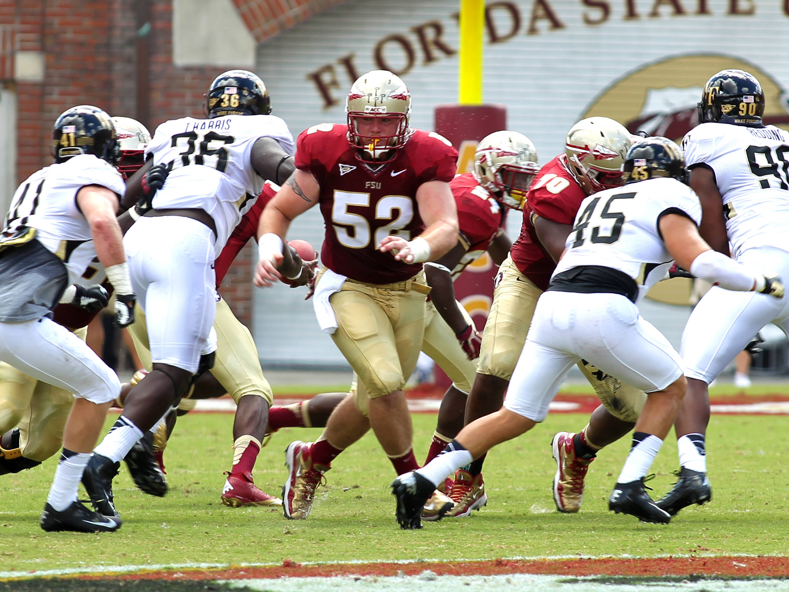 Bryan Stork (52) leading a run, FSU vs Wake Forest, 9/15/12 (Photo by Steve Musco)
