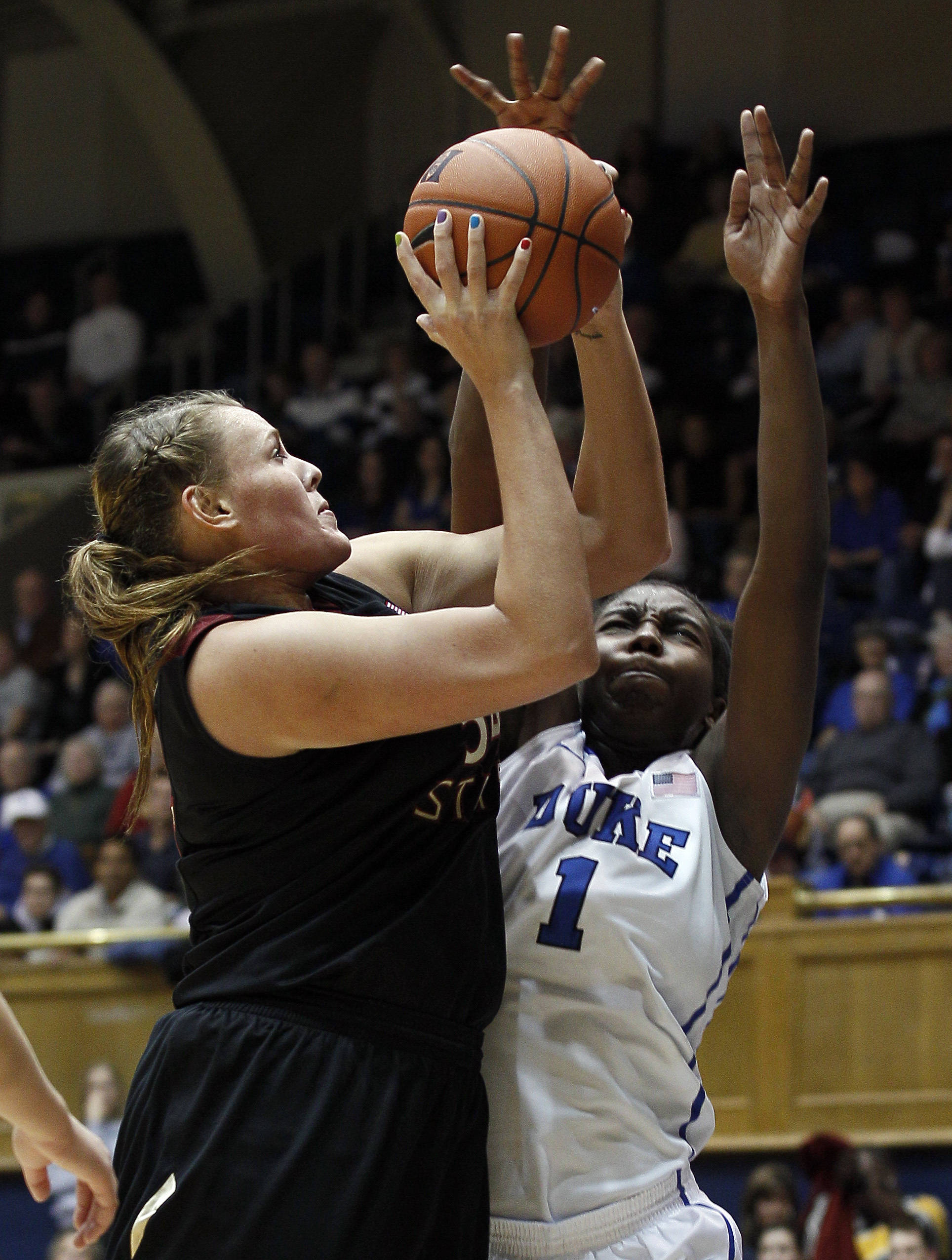 Duke's Elizabeth Williams (1) defends as Florida State's Cierra Bravard shoots during the second half. (AP Photo/Gerry Broome)