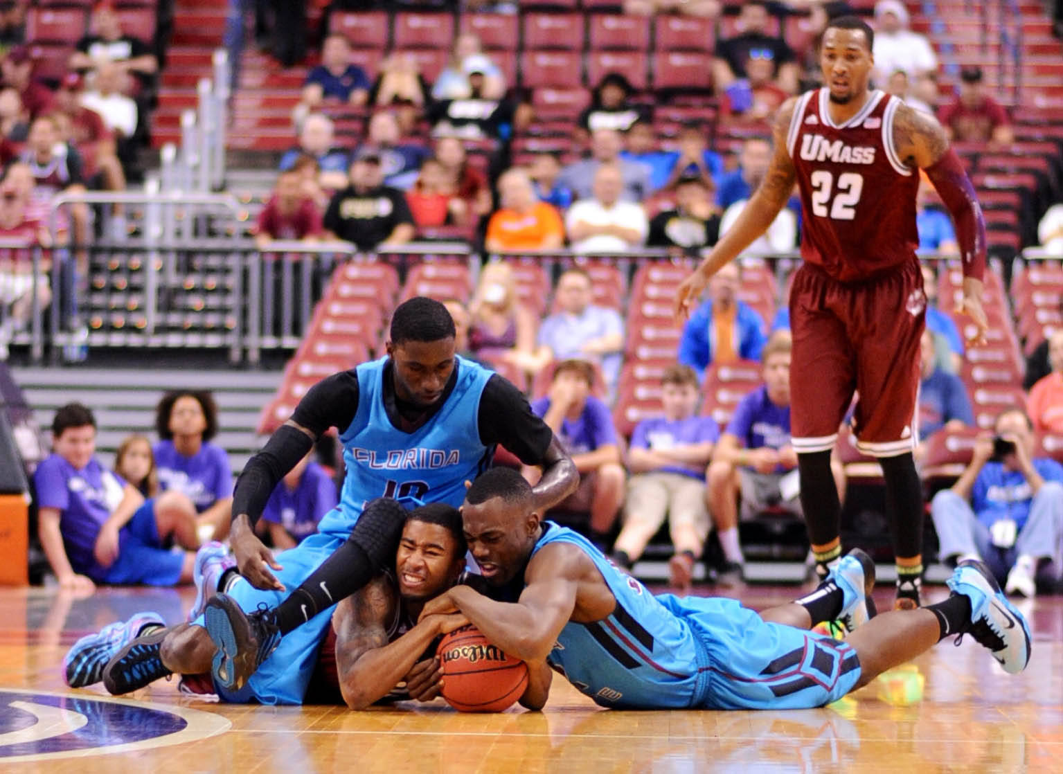 Dec 21, 2013; Sunrise, FL, USA; Florida State Seminoles guard Xavier Rathan-Mayes (right) battles for a loose ball with Massachusetts Minutemen guard Trey Davis (left) as Florida State Seminoles forward Okaro White (top) defends during the first half at BB&T Center. Mandatory Credit: Steve Mitchell-USA TODAY Sports