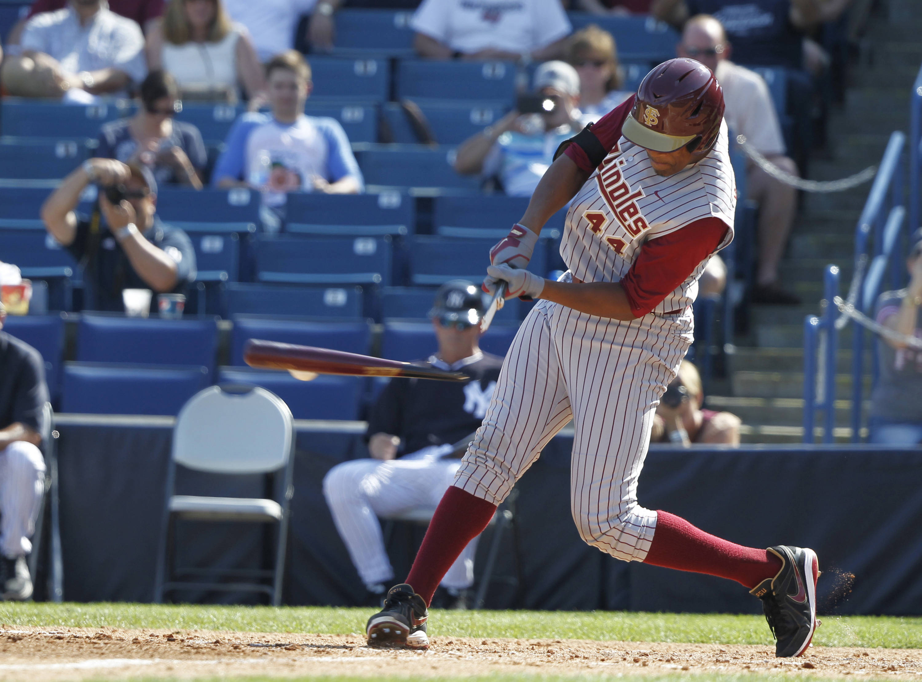 Feb 25, 2014; Tampa, FL, USA;  Florida State Seminoles pitcher/outfielder Jameis Winston (44) breaks his bat during the sixth inning against the New York Yankees at George M. Steinbrenner Field. Mandatory Credit: Kim Klement-USA TODAY Sports