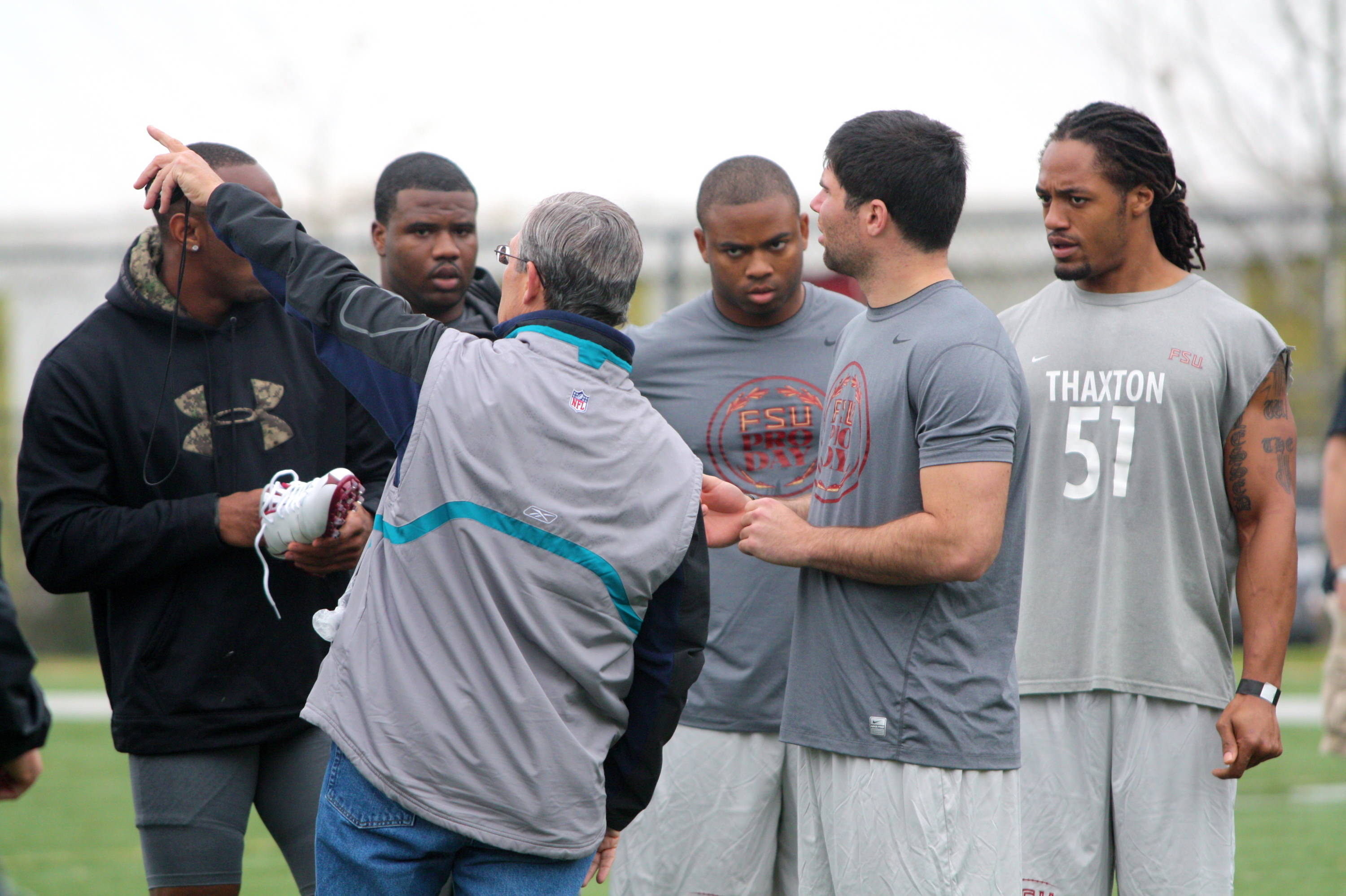 Scout talking with players