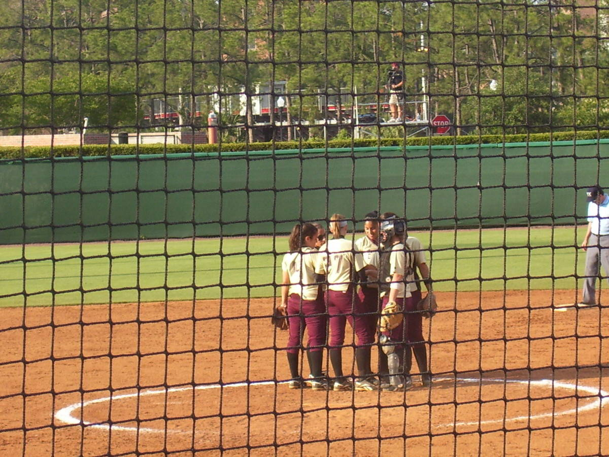 The Seminoles regroup on the mound.