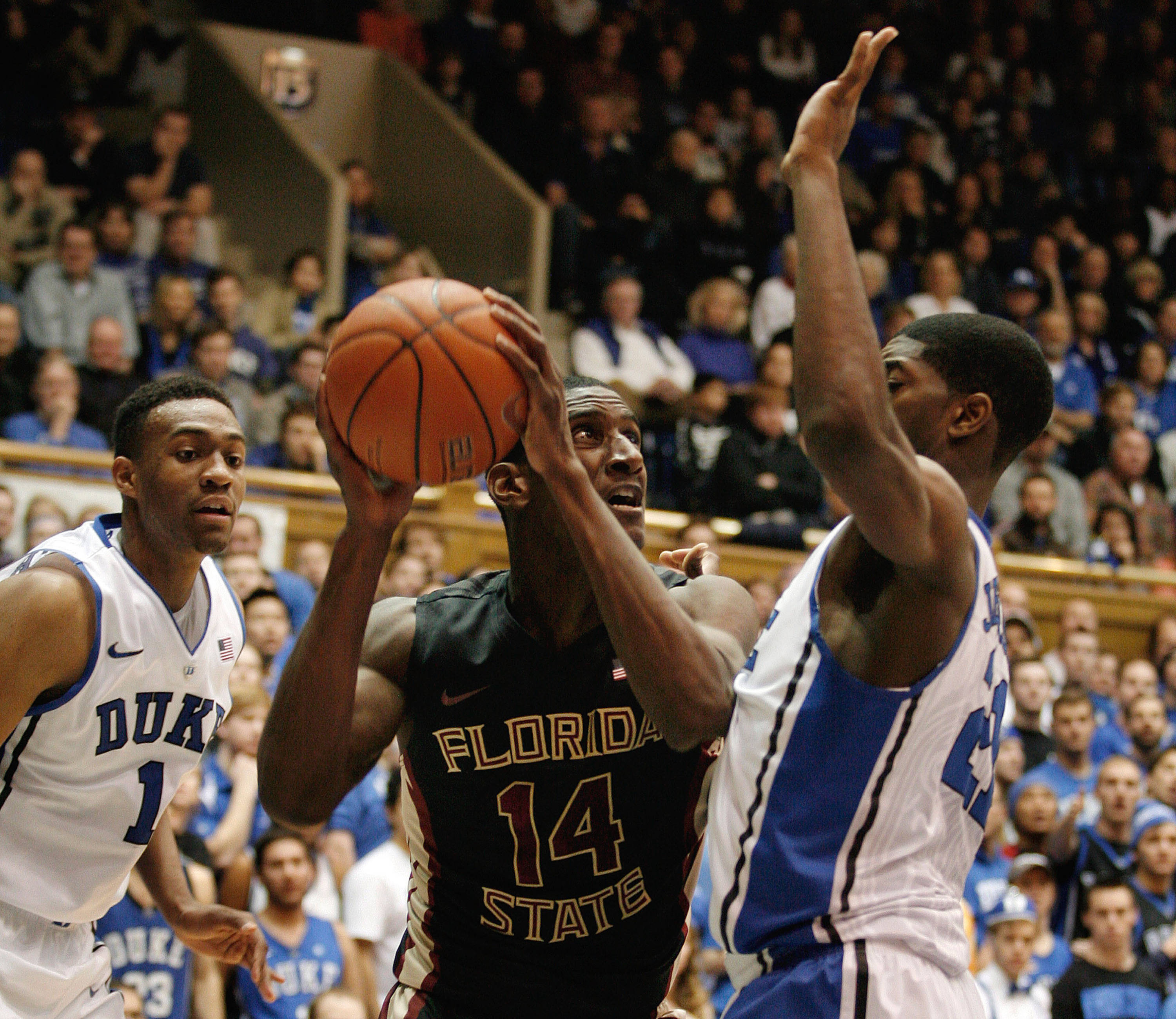 Jan 25, 2014; Durham, NC, USA; Seminoles forward Robert Gilchrist (14) drives against Duke Blue Devils forward Amile Jefferson (21). Mark Dolejs-USA TODAY Sports