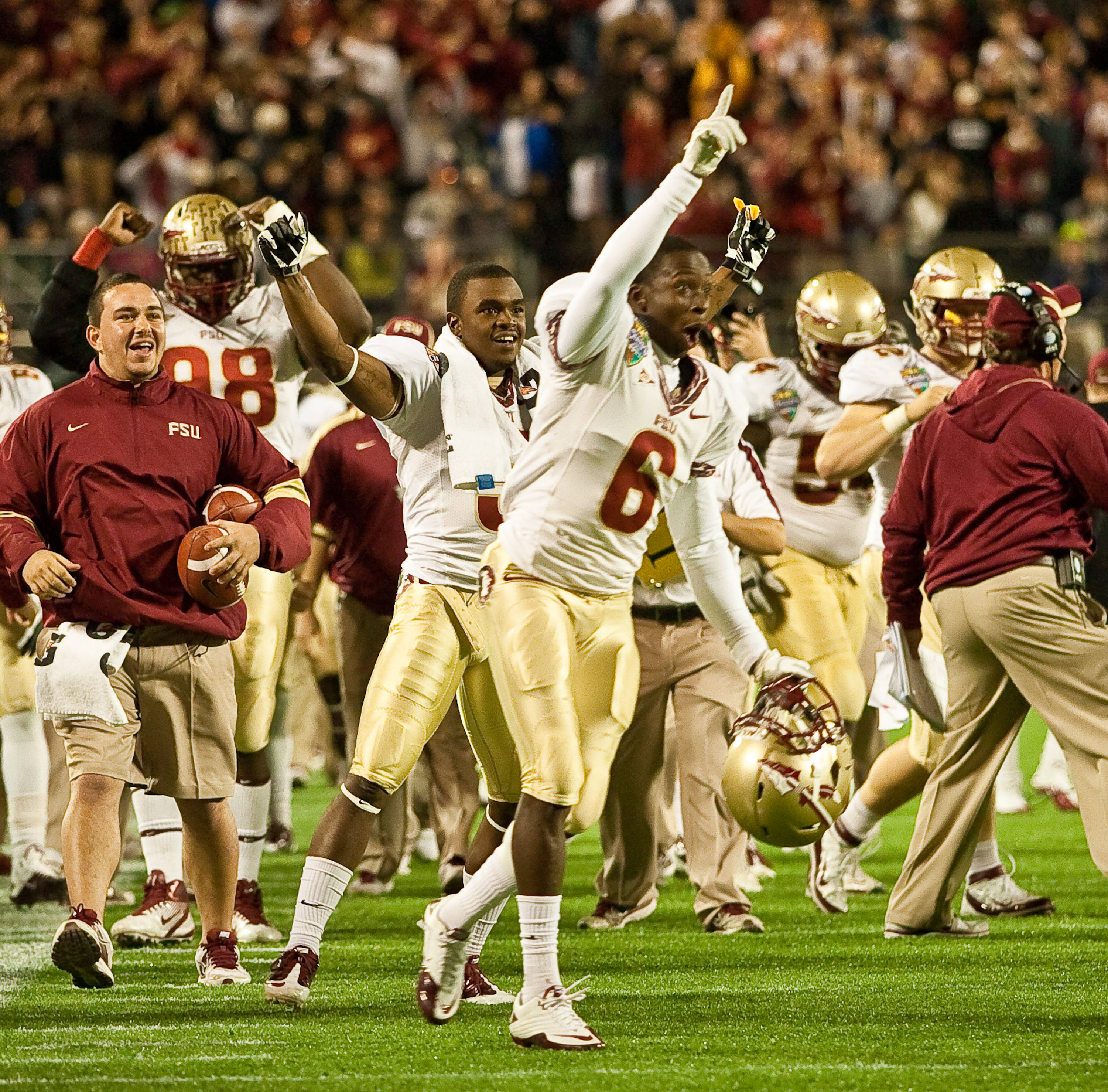 The Seminoles celebrate on the sidelines