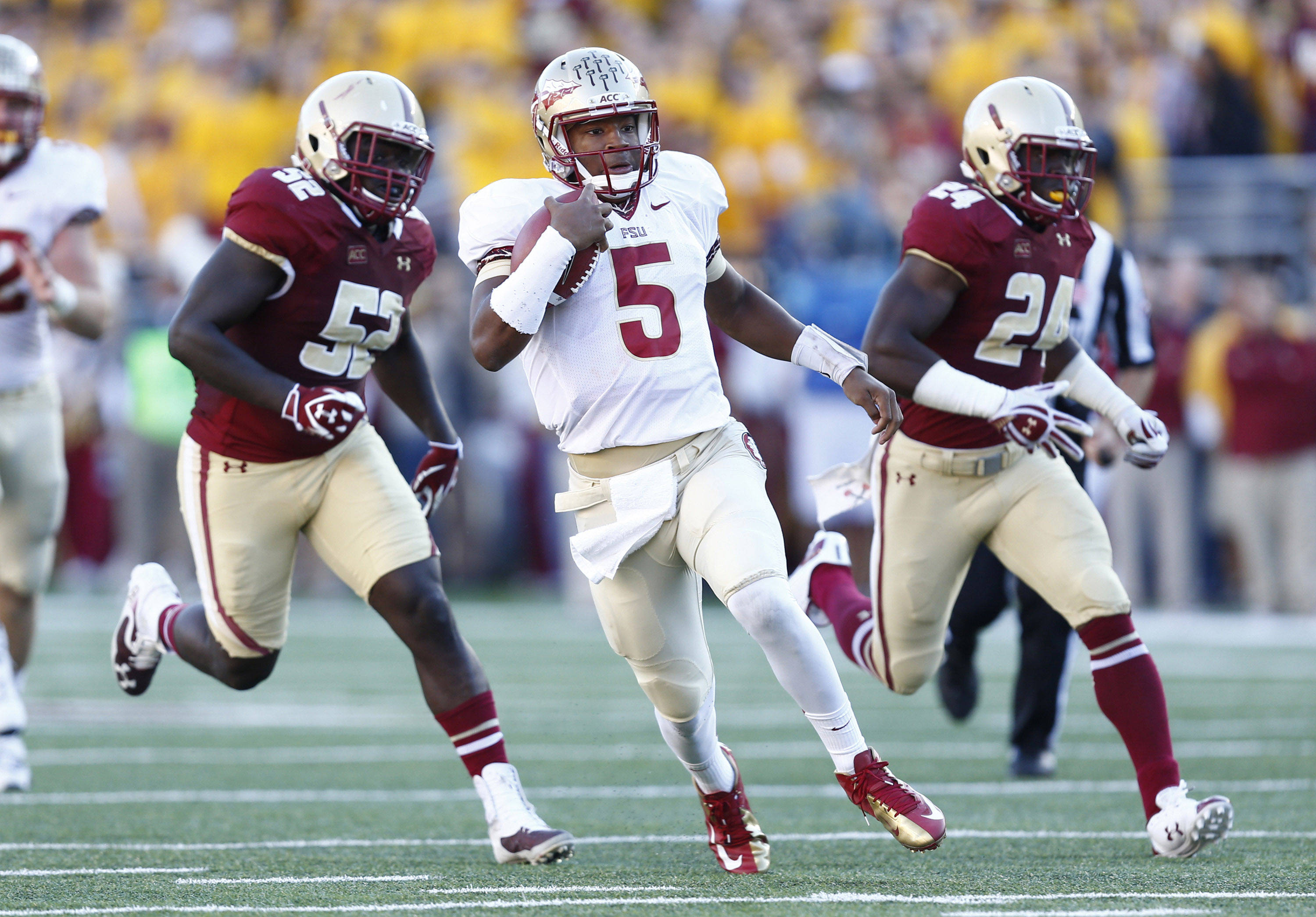 Jameis Winston (5) runs the ball. Mandatory Credit: Mark L. Baer-USA TODAY Sports