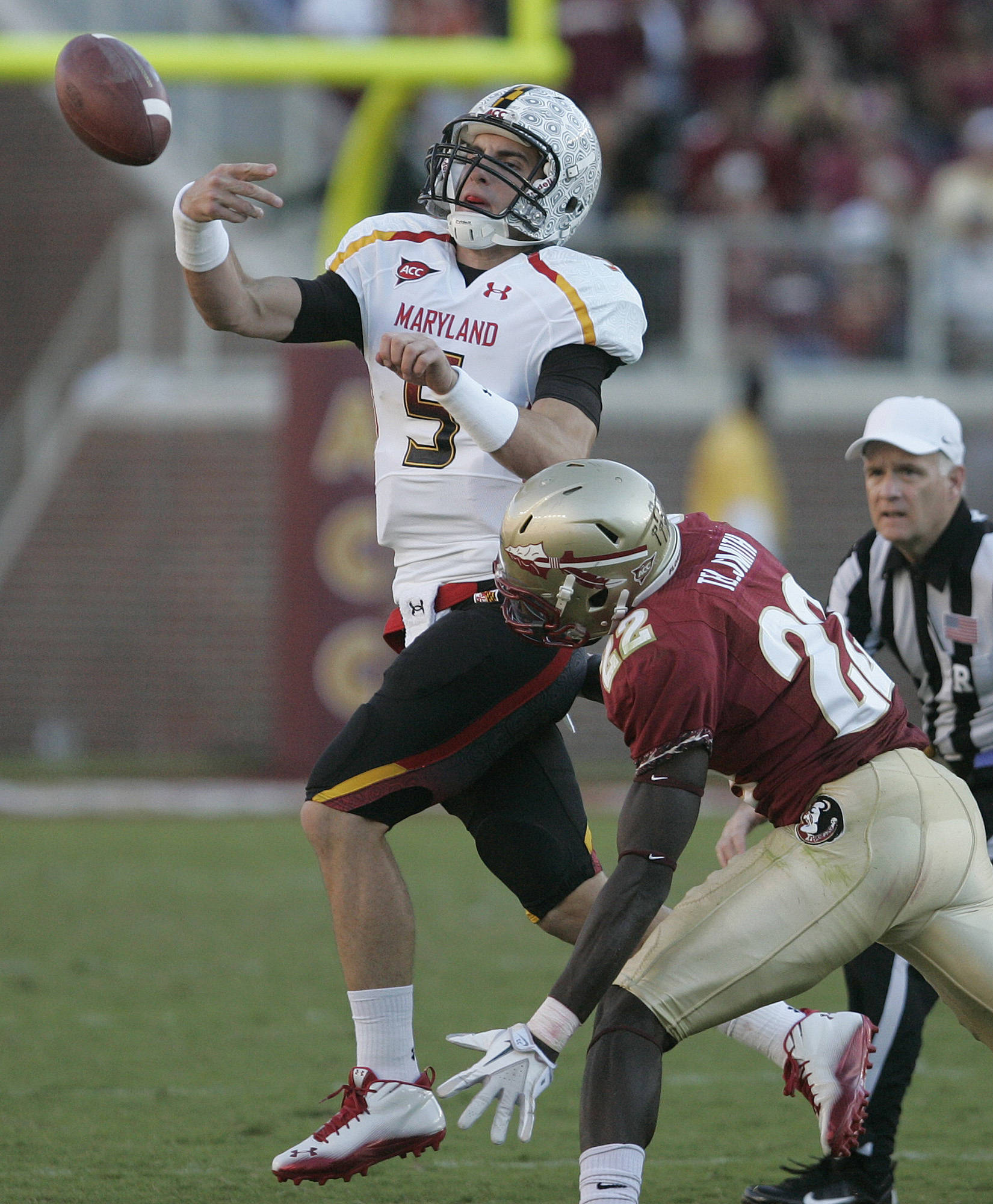 Maryland quarterback Danny O'Brien is almost sacked by Florida State's Telvin Smith in the third quarter. O'Brien was called for grounding. AP Photo/Steve Cannon)